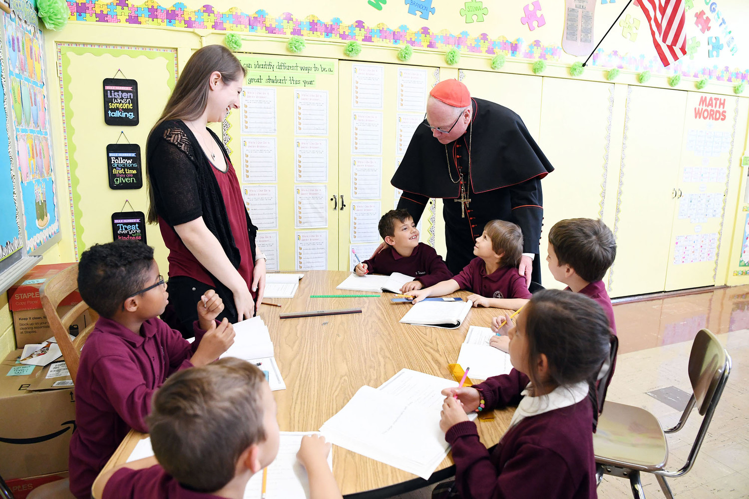Cardinal Dolan visits teacher Jennifer Nygard's second-grade class at St. Teresa's School on Staten Island Oct. 5. The cardinal also celebrated Mass for the school's students and staff. St. Teresa's successful showing in the archdiocese's Renew + Rebuild parish fund-raising campaign means air conditioning will be installed in school classrooms and in Conran Hall.