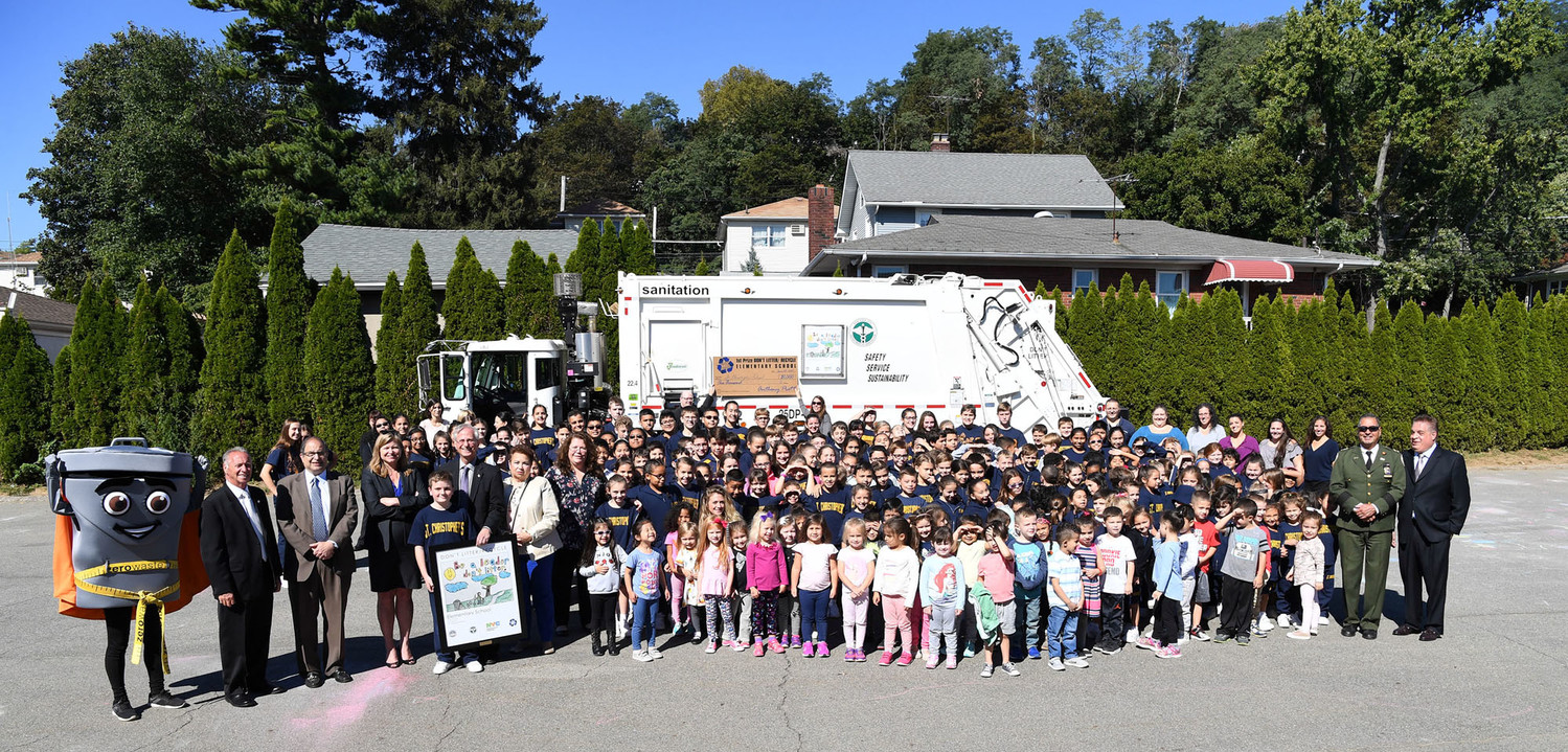 The students of St. Christopher's School on Staten Island pose with the dignitaries in front of the sanitation truck.
