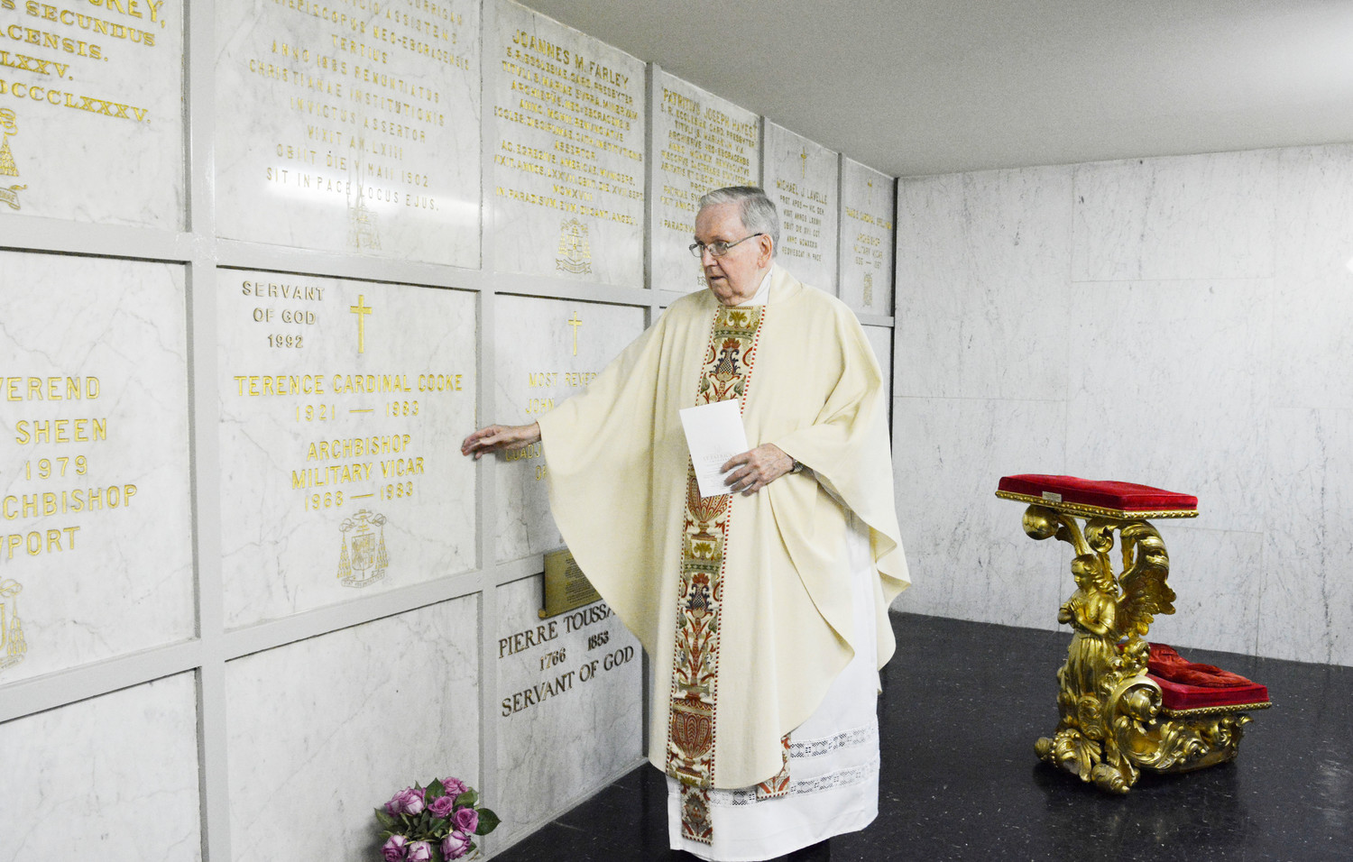 Msgr. Peter G. Finn, pastor of Blessed Sacrament parish on Staten Island, prays at Cardinal Terence Cooke's crypt below the main altar of St. Patrick's Cathedral.