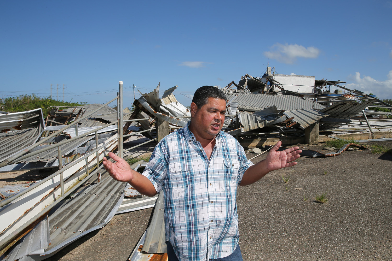 DESTRUCTION—Dairy farmer Gustavo Tirado, who is Catholic, stands near his destroyed farm buildings Oct. 22 in Hatillo, Puerto Rico, more than one month after Hurricane Maria devastated the island.