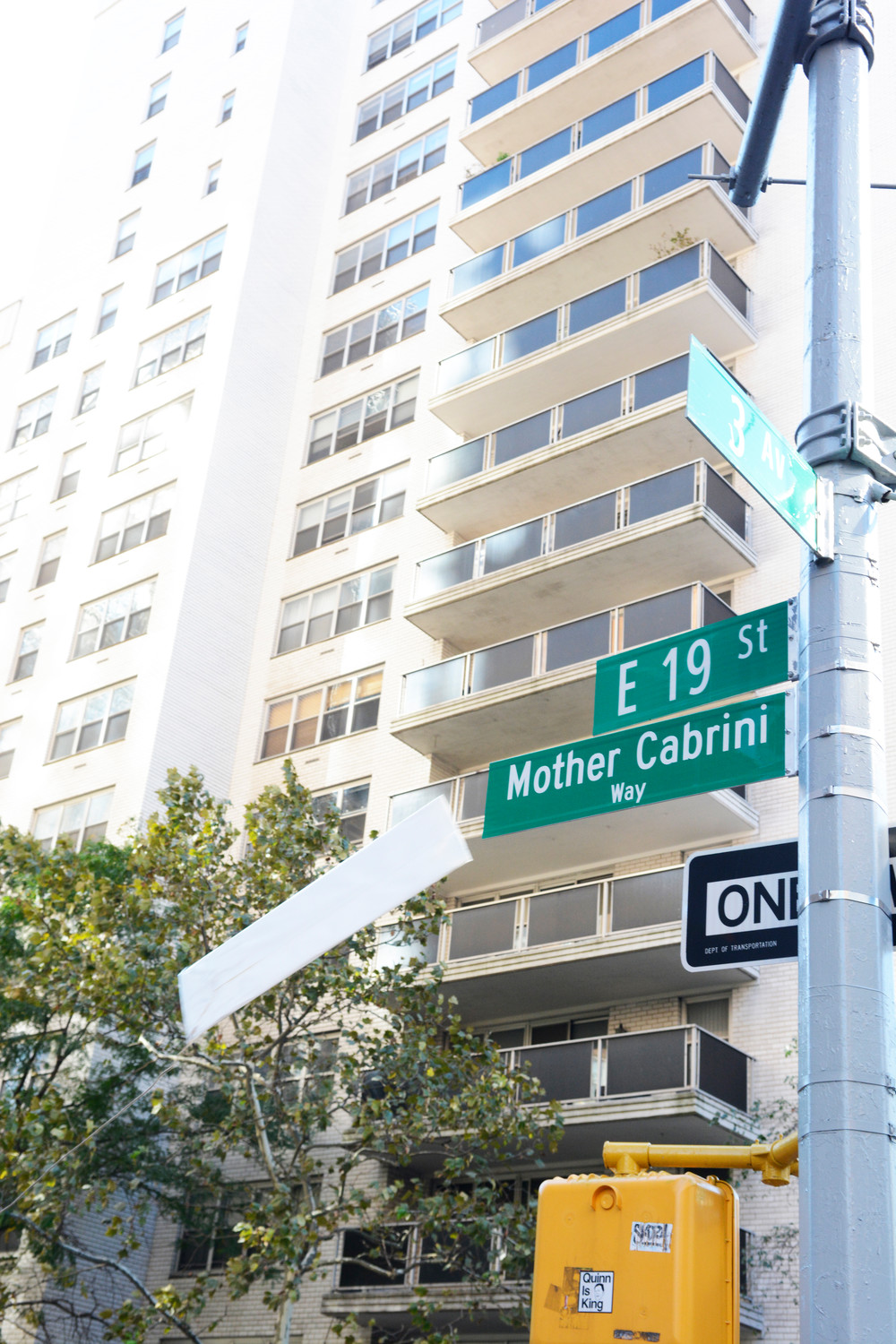The cover falls from the new street sign. Light refreshments followed at Cabrini Apartments at 220 E. 19th St.