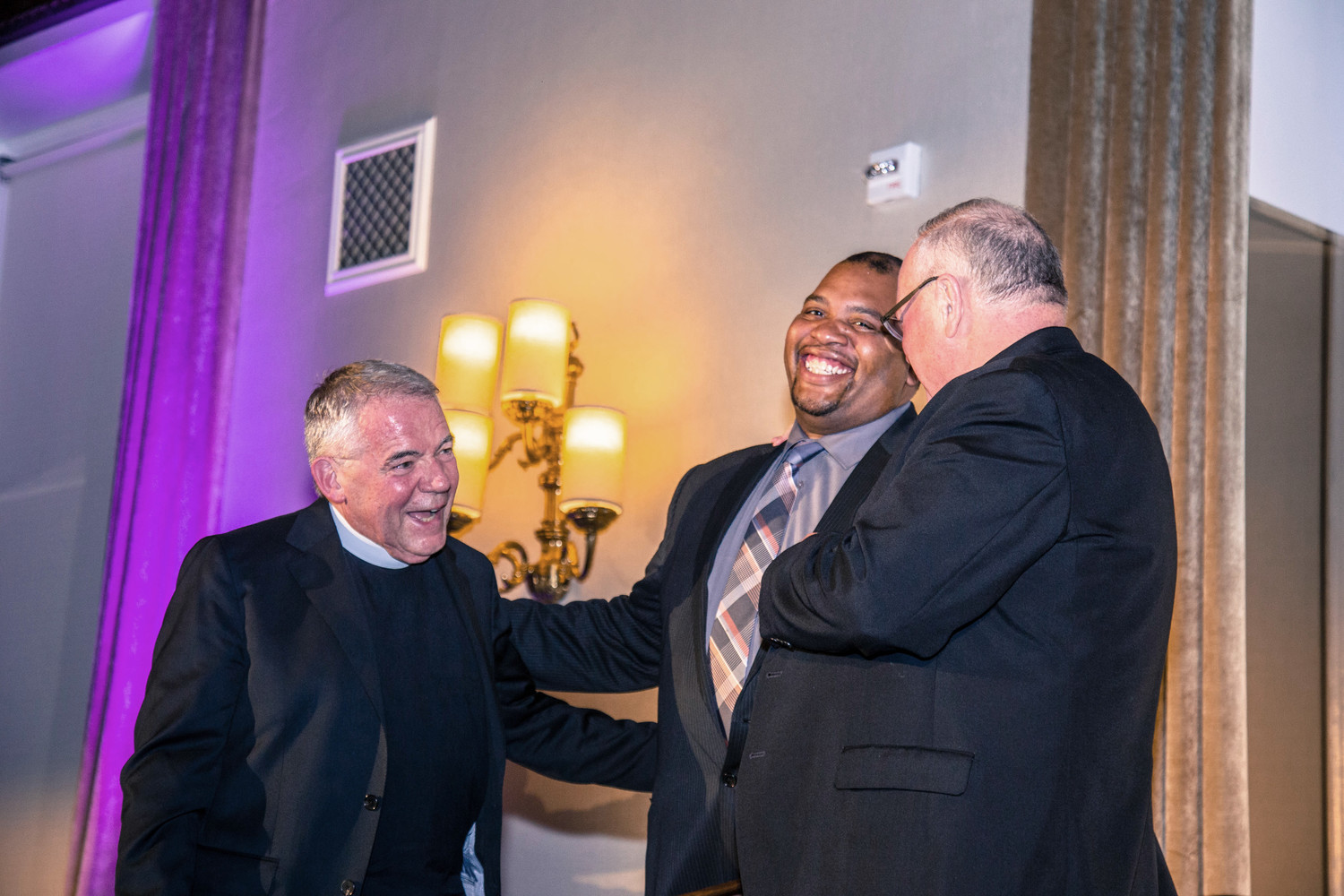 Father John P. Duffell, pastor of the Blessed Sacrament parish in Manhattan, and Jerome Pannell, assistant principal of student services at La Salle Academy in Manhattan, accepted the posthumous award to Msgr. Howard W. Calkins, a former pastor of parishes in the archdiocese; at right is Cardinal Dolan.