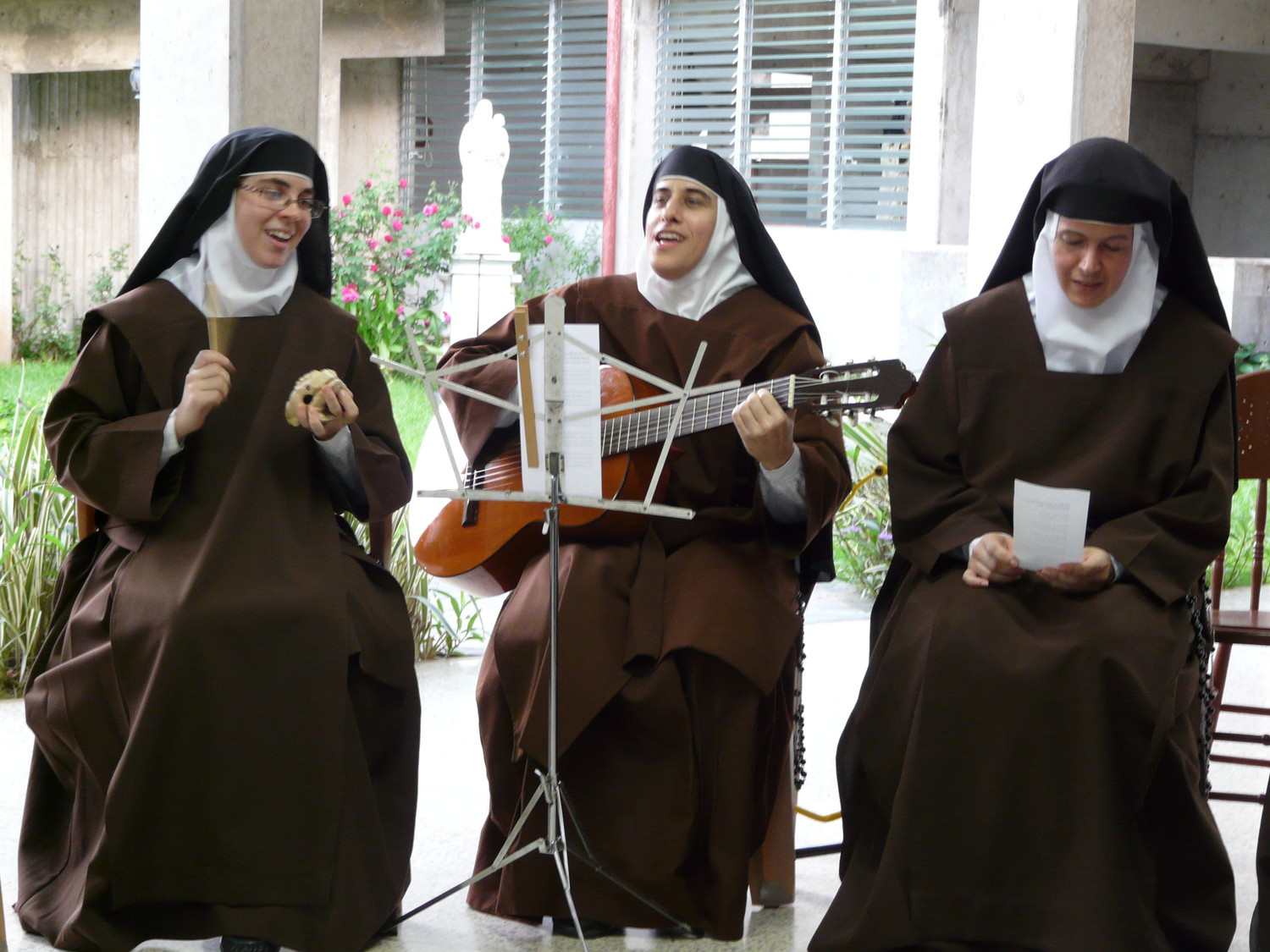 WELCOME—Carmelite Sisters perform a song welcoming San Juan Archbishop Roberto Gonzalez and Cardinal Dolan and the other visitors from New York to St. Joseph's Monastery in Trujillo Alto Oct. 30.