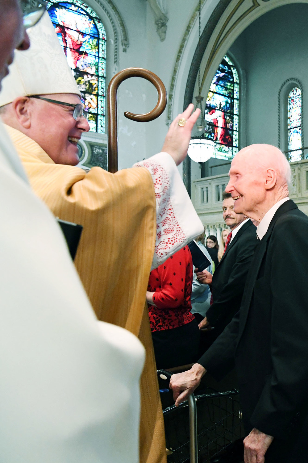 Cardinal Dolan paused to greet Brother James Kelly, F.S.C., a former principal of St. Peter's, at the end of Mass.
