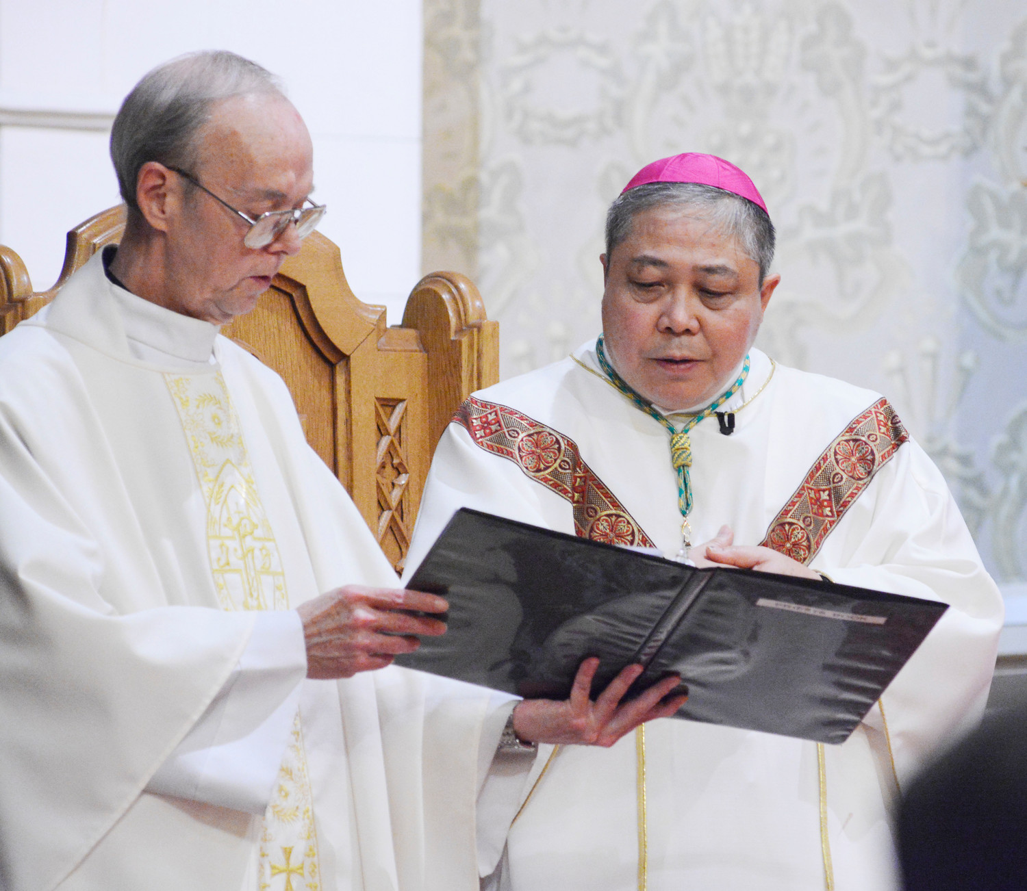 Archbishop Bernardito Auza, permanent observer of the Holy See to the United Nations, served as principal celebrant. Msgr. John Ferry, the parish pastor, to the archbishop's left, was a concelebrant.