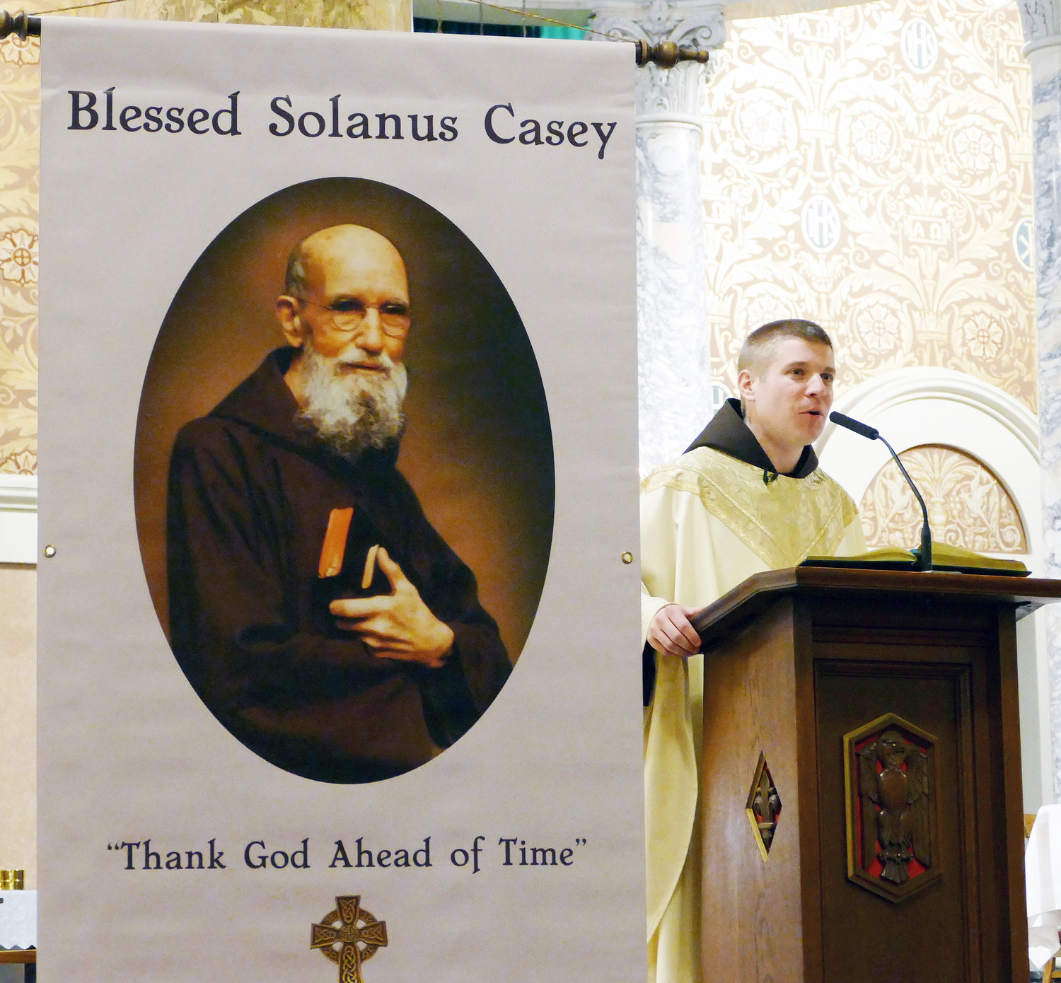 Father Matthew Janeczko, O.F.M. Cap., pastor of Sacred Heart parish in Yonkers, preaches his homily at a Vigil Mass honoring Blessed Solanus Casey in the church where the friar served for 14 years in the early part of the 20th century.