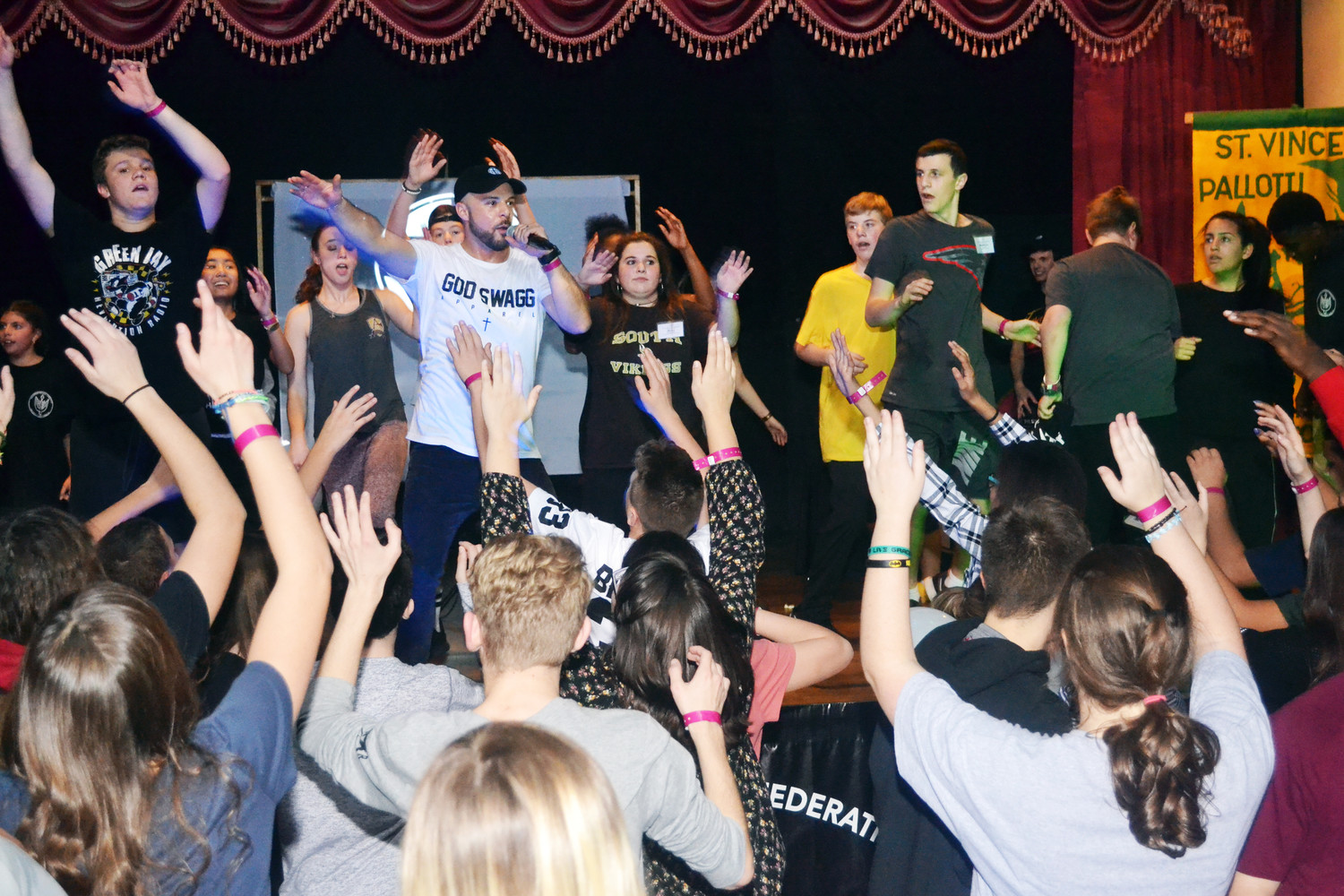 Teens dance at a performance by Joe Melendrez of Joe Melendrez Ministries in California during the Pallottine Teenage Federation Conference at Honor's Haven Resort & Spa in Ellenville Dec. 2.