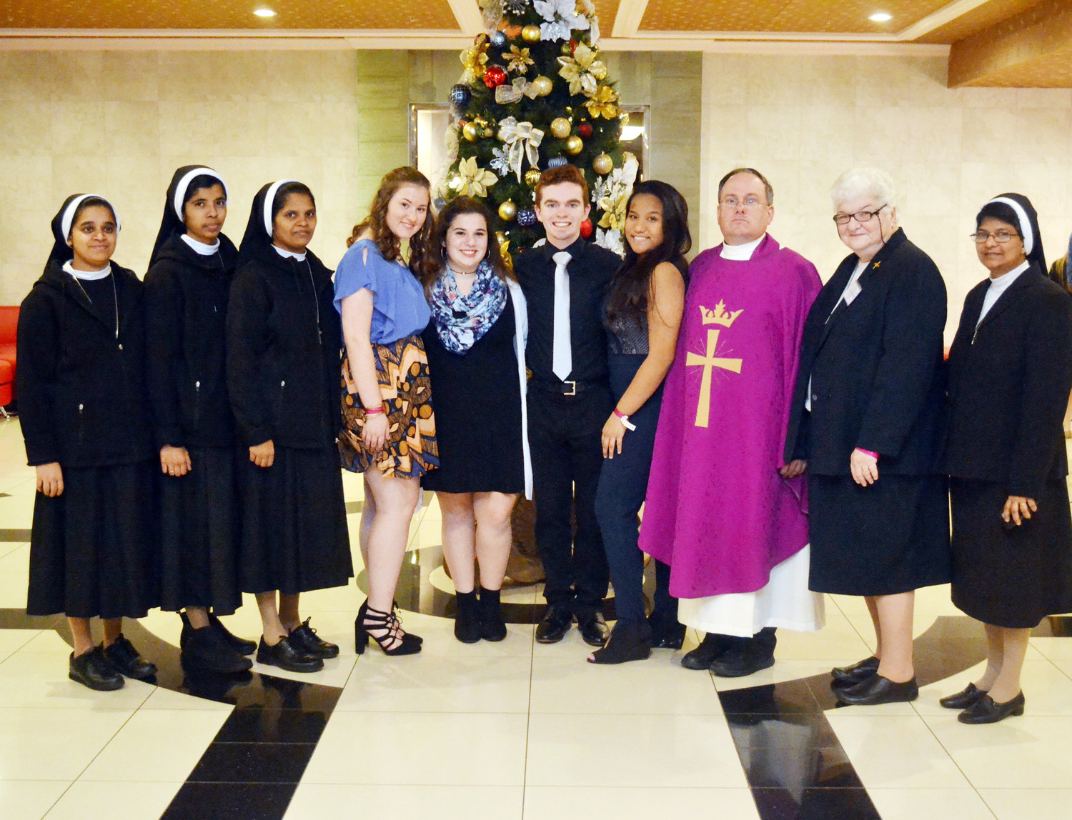 Sister Laucena Bennis, C.S.A.C.; Sister Smija Peter, C.S.A.C.; Sister Roseline Jayaraj, C.S.A.C.; Father Michael Martine; Sister Michele Ruggerio, C.S.A.C.; and Sister Shinty Anthony, C.S.A.C. join the new PTAF officers Emma Cranston, Alexa Verderame, John McKiernan and Victoria Bruno.