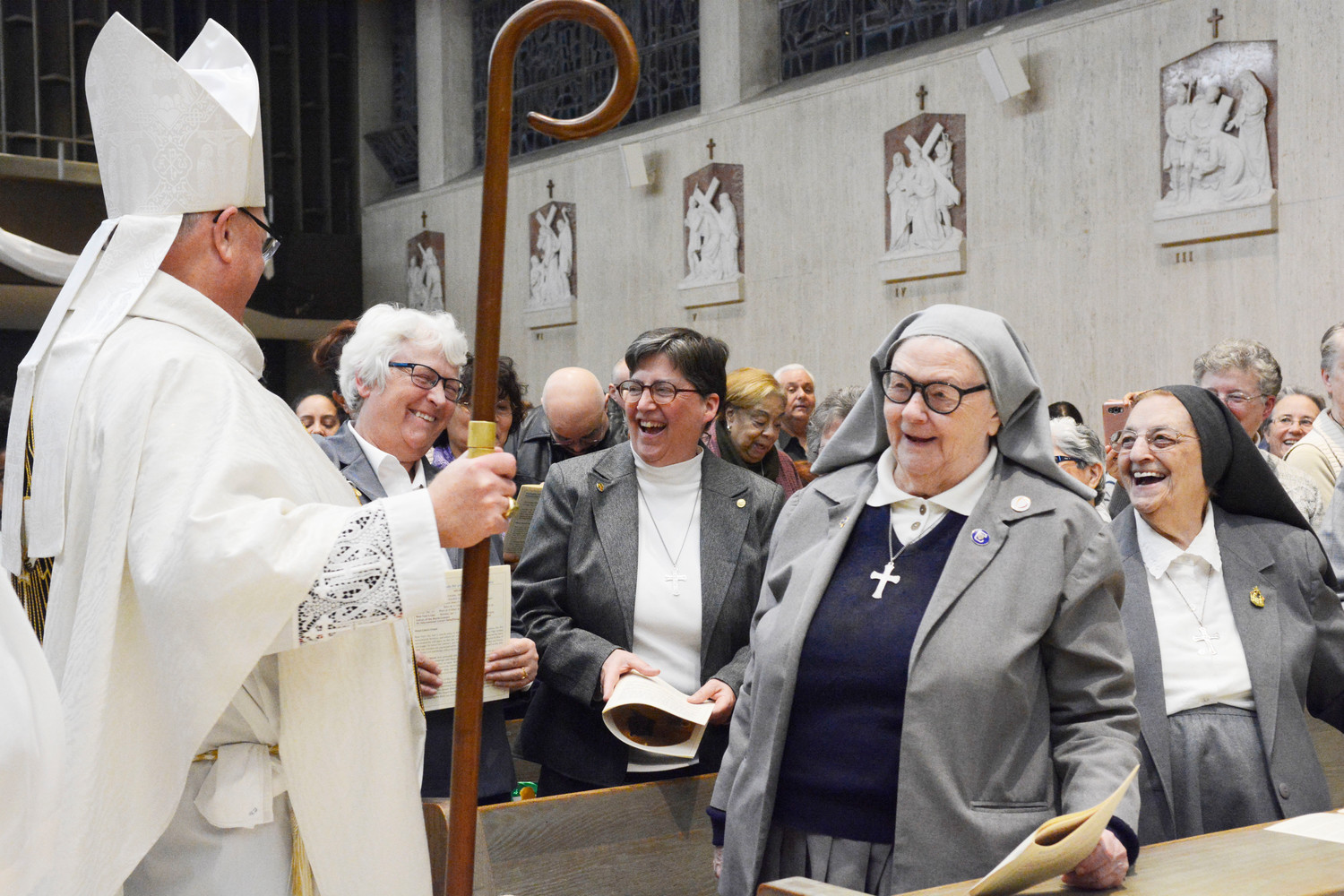 Cardinal Dolan speaks with Missionary Sisters of the Sacred Heart of Jesus, including Sister Barbara Louise Staley, M.S.C., general superior, second row left, at St. Frances Cabrini Shrine in Manhattan Dec. 16.