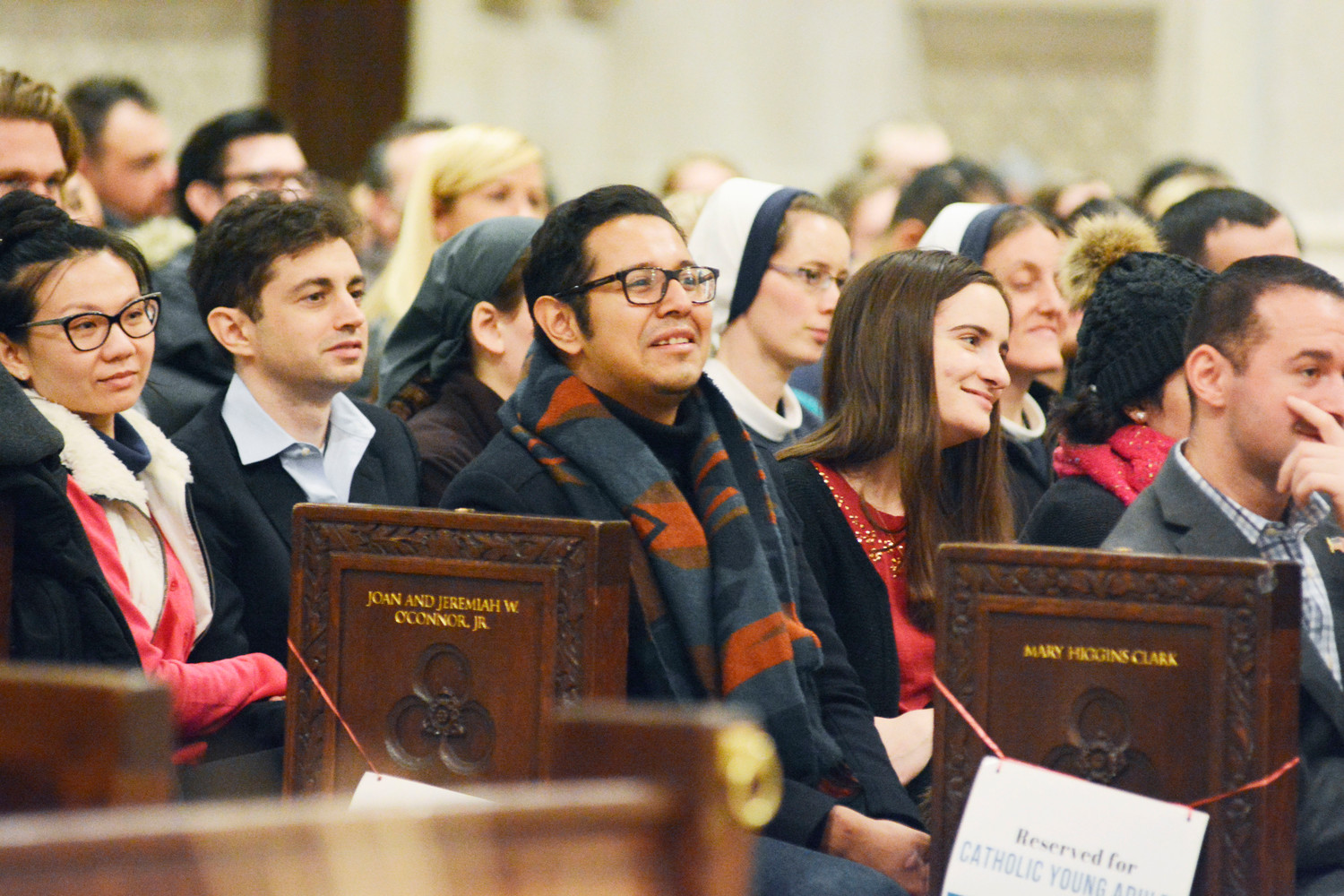 everal hundred young adults attended a Mass celebrated by Father Emmanuel Mansford, C.F.R., at St. Patrick's Cathedral Dec. 13. The Mass was sponsored by the archdiocese's Office of Young Adult Outreach.