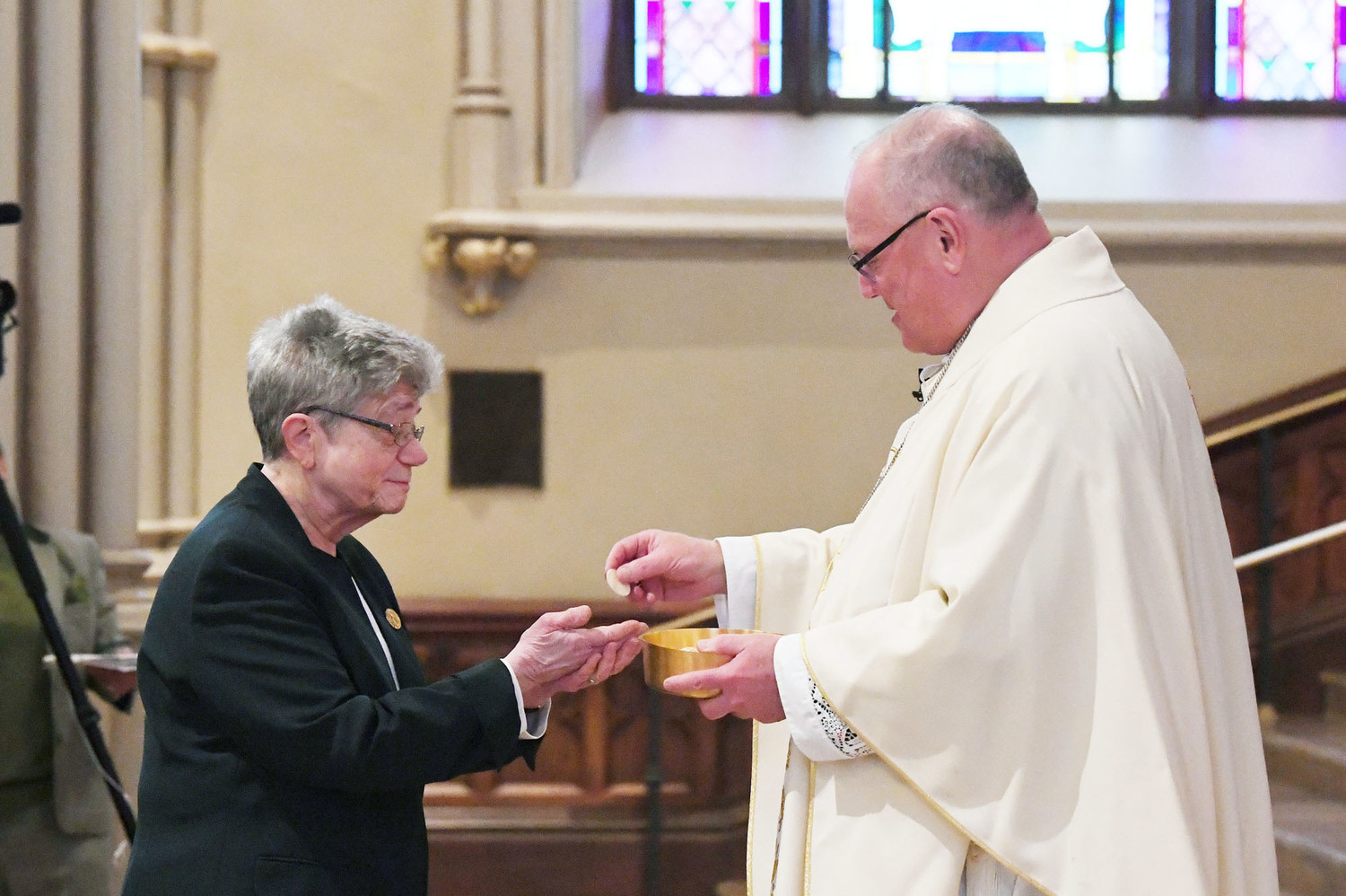 Sister Jane Iannucelli, S.C., president of the Sisters of Charity of New York, receives Communion from Cardinal Dolan.