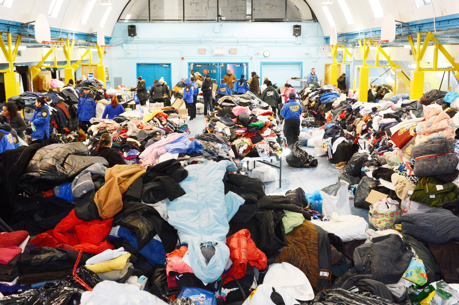 Generous donations from a community-wide clothing and food drive for the fire survivors are seen from the stage of the gymnasium at the former St. Martin of Tours School in the Bronx.