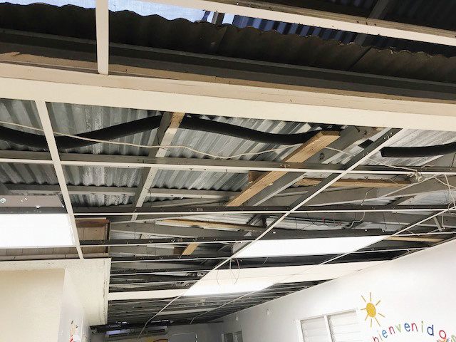 The roof of a Foundling Head Start center in Coamo shows heavy damage from Hurricane Maria.