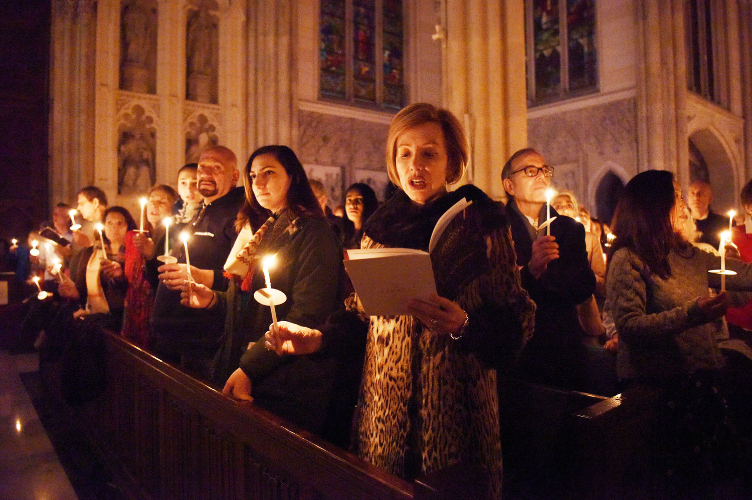 "The audience holds lit candles as they sing ""Silent Night,"" the last song of the 38th annual ""A City Singing at Christmas"" concert at St. Patrick's Cathedral Dec. 21."