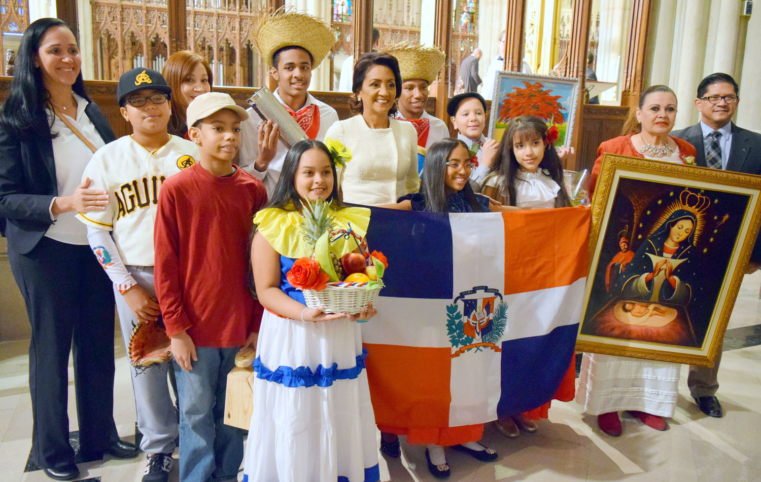 Candida Montilla de Medina, first lady of the Dominican Republic, poses with gift bearers and the image of Our Lady of Altagracia at a Mass at St. Patrick's Cathedral Jan. 14. The Mass was in honor of Our Lady of Altagracia, the protectress of the Dominican Republic.