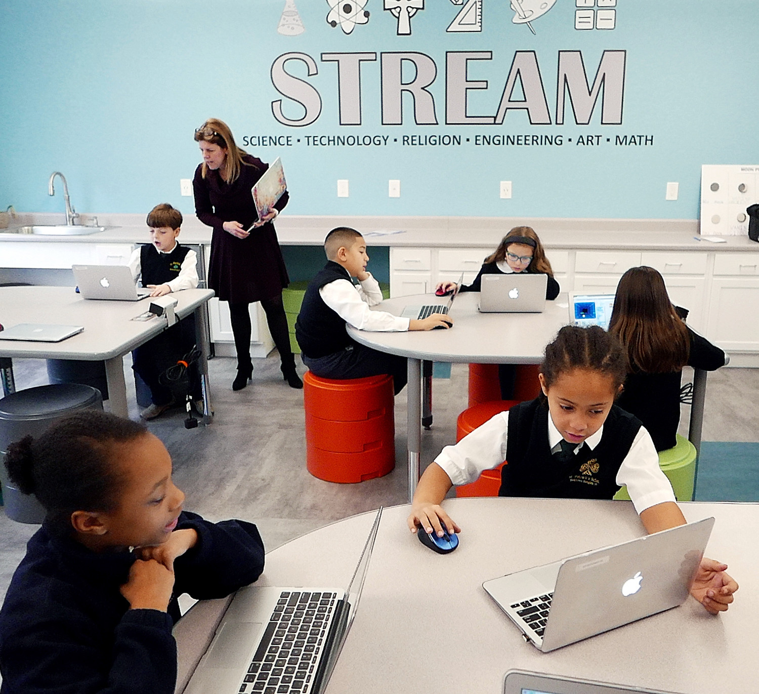Computer technology instructor Jennifer Vespucci works with students in the Stream Center at St. Patrick's School in Yorktown Heights Jan. 11. St. Patrick's is one of 34 archdiocesan elementary schools using the Blended Learning teaching model this year.