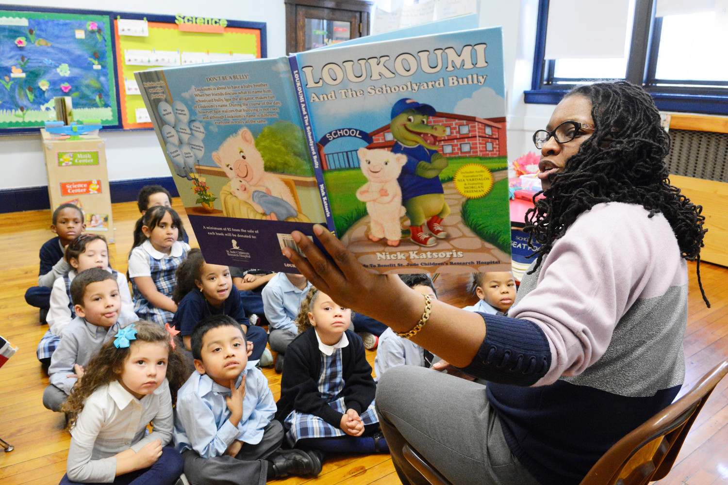 "Sherri Boskey, a kindergarten teacher at Our Lady of Lourdes School in Manhattan, reads ""Loukoumi and the Schoolyard Bully"" to her students last week. Elementary schools of the archdiocese have incorporated the book series into the Values Infusion program."