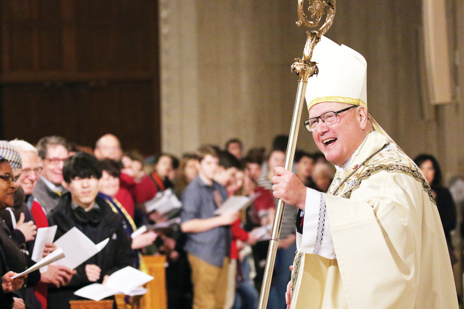 Cardinal Dolan, chairman of the U.S. Bishops' Committee on Pro-Life Activities, smiles as he processes from the sanctuary after celebrating the Mass.