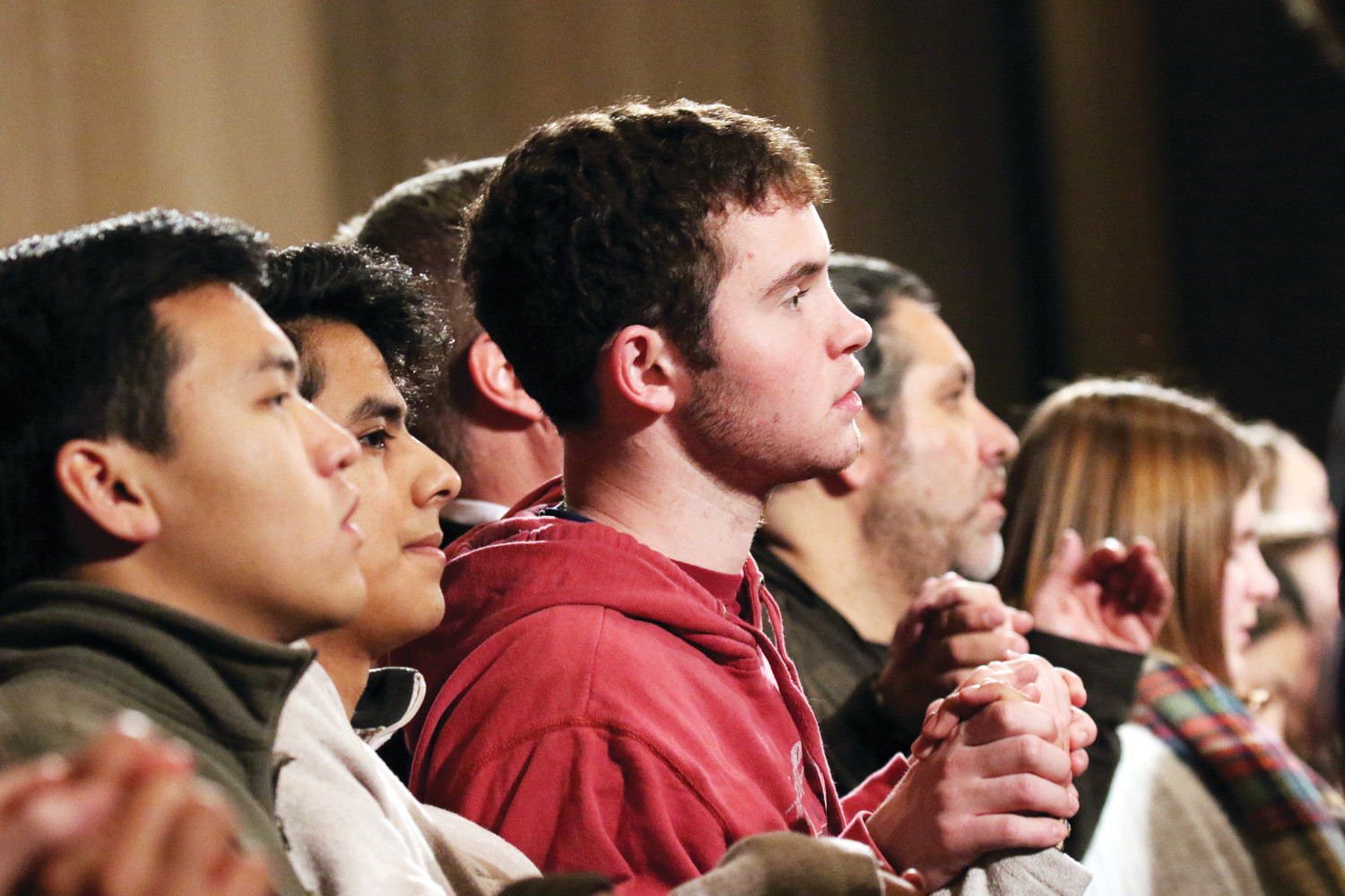 Young people join hands as they pray the Lord's Prayer during the opening Mass of the National Prayer Vigil for Life at the Basilica of the National Shrine of the Immaculate Conception in Washington, D.C., Jan. 18.