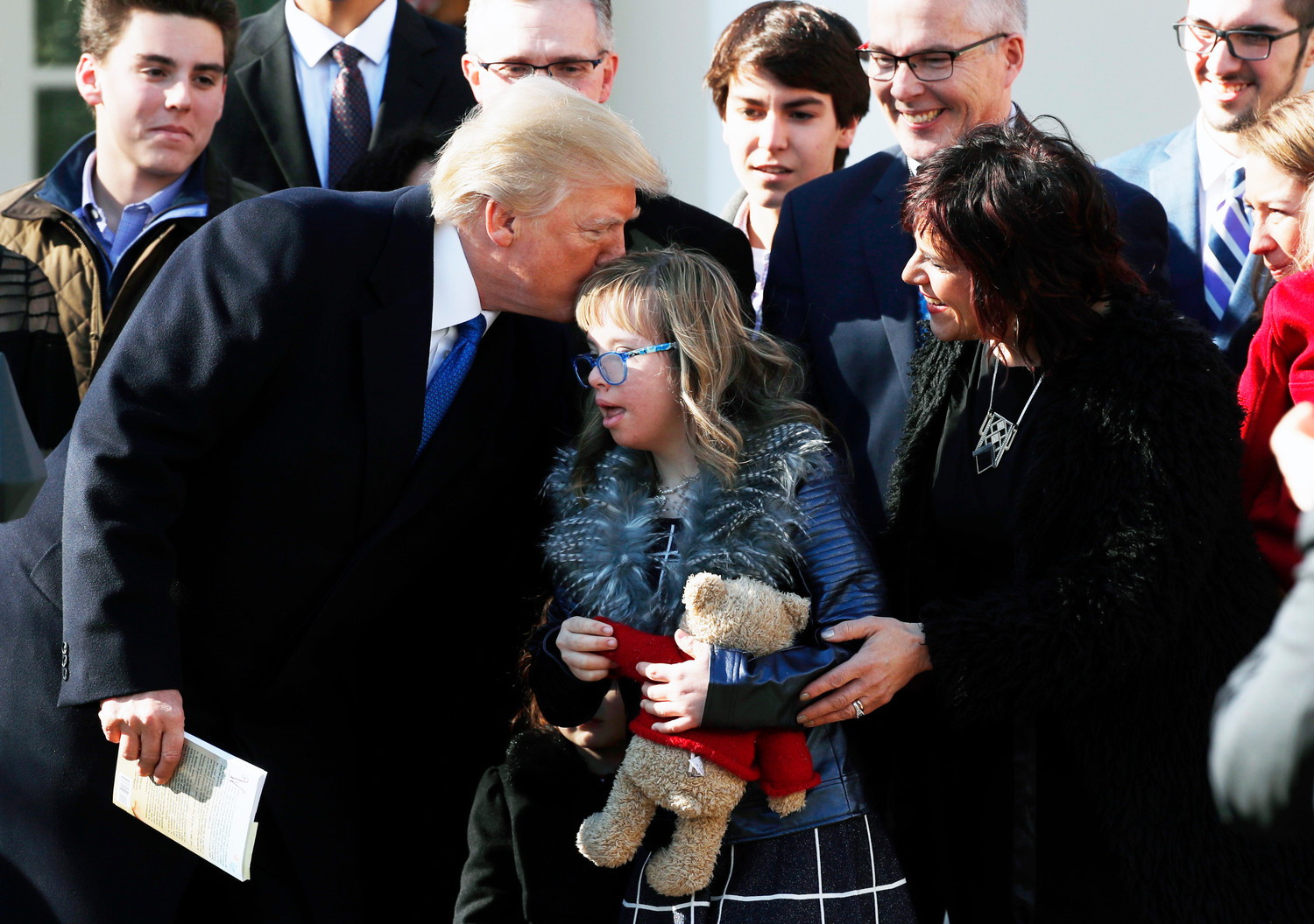 President Donald Trump greets a girl after addressing participants at the March for Life rally from the Rose Garden at the White House.