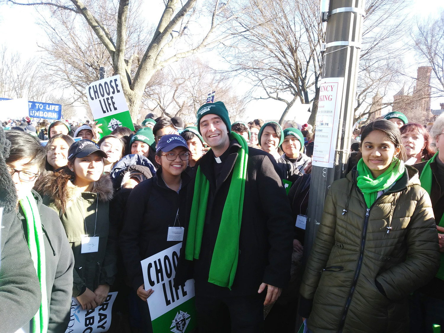 Father Vincent Druding, parochial vicar at Assumption parish in Peekskill, stands with parish teens and adults at the National Mall before beginning the March for Life. The parish sent a busload of 45 teens and chaperones the night before to participate in a youth rally, and a second bus with 30 people left Peekskill the morning of the rally and march.