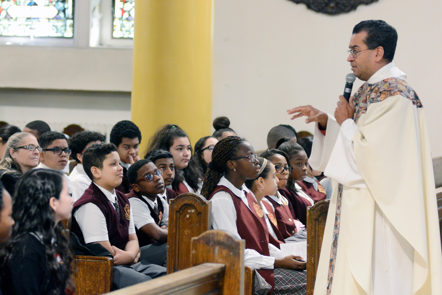Father Eric Cruz, pastor of St. John Chrysostom parish in the Bronx, speaks to students as he celebrates the Eighth-Grade Mass of Solidarity for Hurricane Victims at St. John Chrysostom Church Jan. 24. About 450 eighth-grade students from 15 Catholic schools in the Northwest/South Bronx Region of the archdiocese attended the Mass.