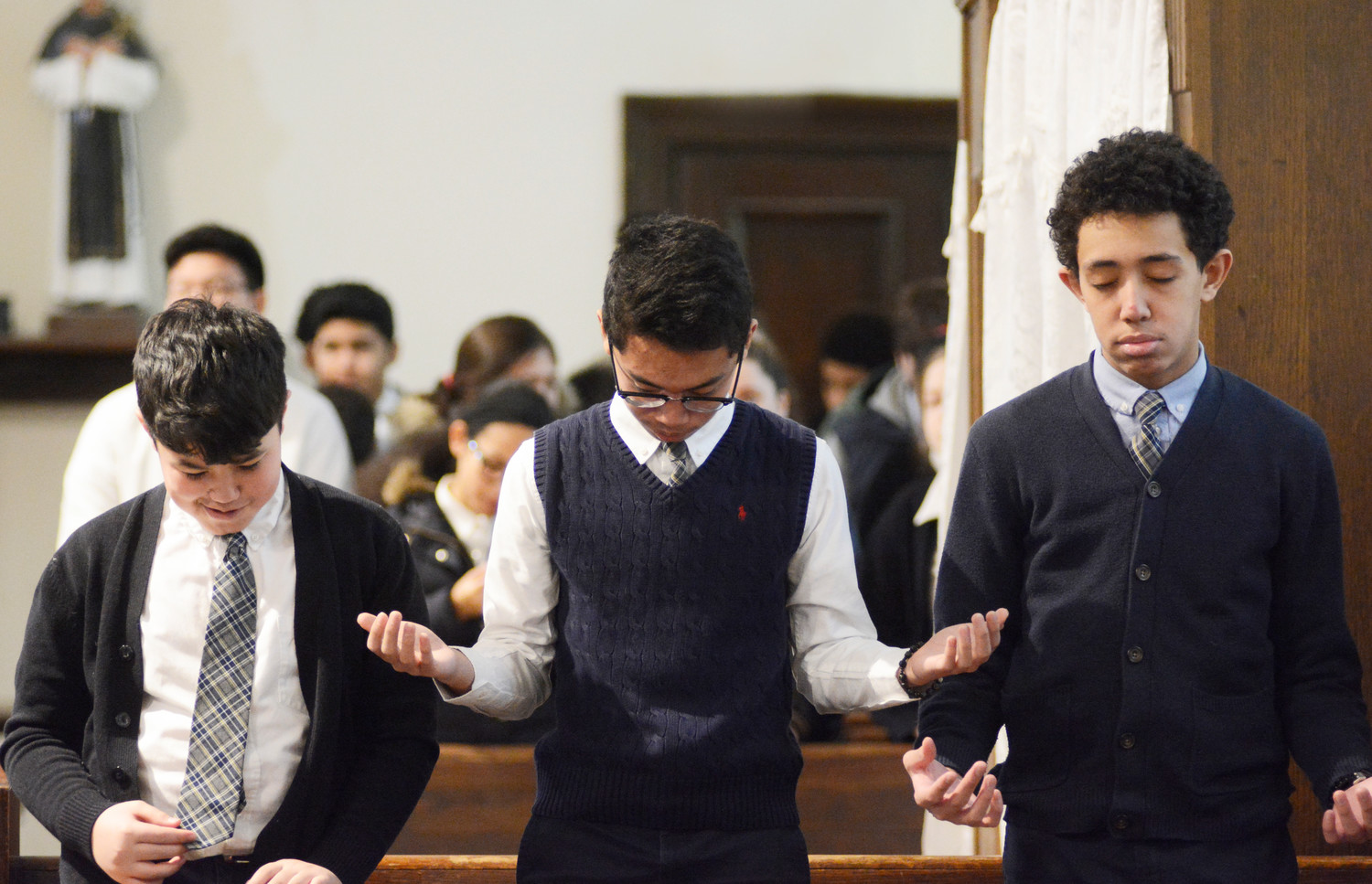 About 450 eighth-grade students from 15 Catholic schools in the Northwest/South Bronx Region of the archdiocese attended the the Eighth-Grade Mass of Solidarity for Hurricane Victims at St. John Chrysostom Church Jan. 24.