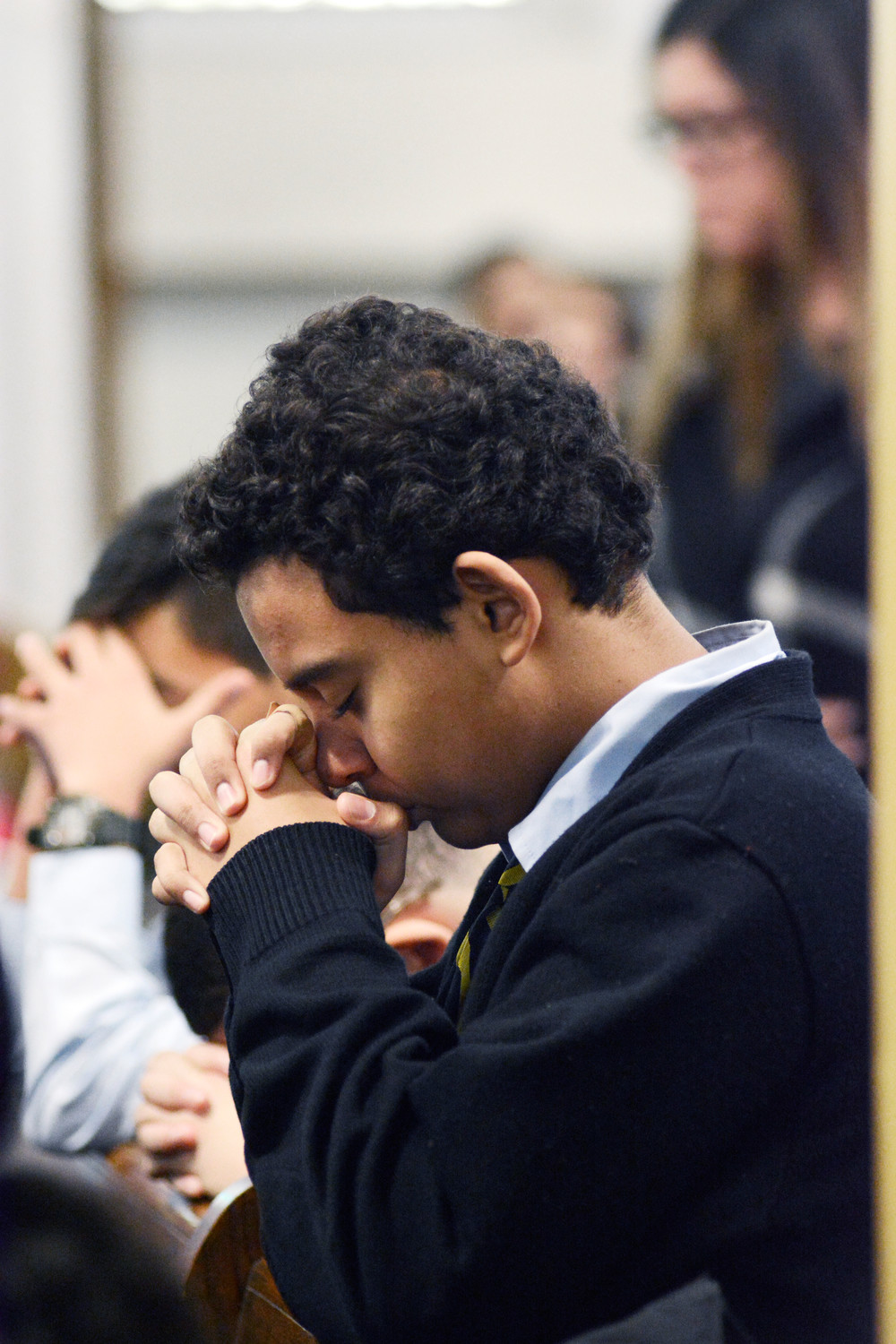 A student prays after Communion.