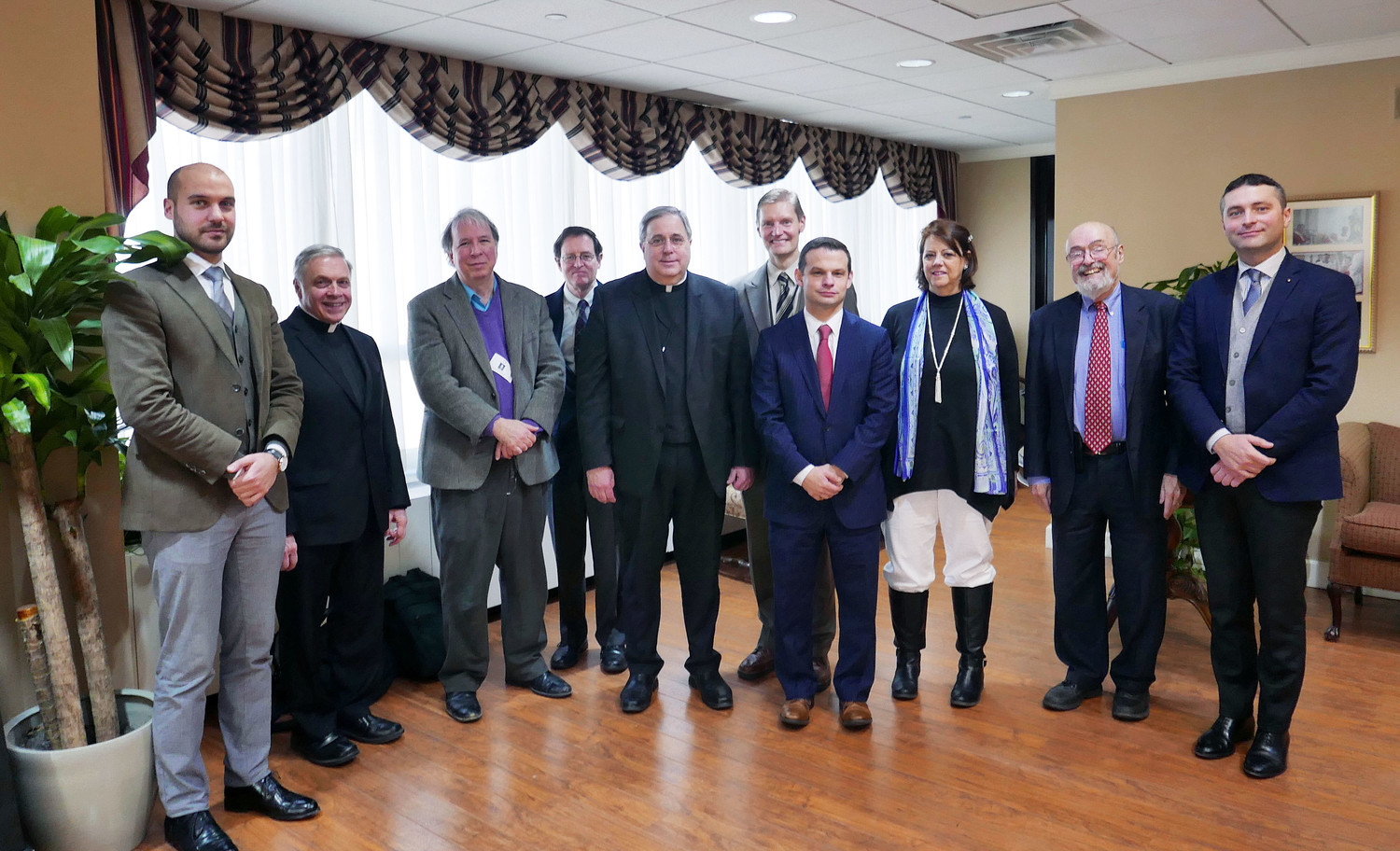 officials of the inquiry met with Dr. Hilgeman, right, and Dr. Spedicator, left. They include Msgr. Stephen DiGiovanni, Diocese of Bridgeport, chairman of the historical commission; historical commission members Robert Ellsberg and Patrick Jordan; Father Richard Welch, C.Ss.R., judicial vicar of the Metropolitan Tribunal and the Cardinal's delegate for the cause; Jeff Korgen, staff member for the Dorothy Day Guild; Dr. Daniel Frascella, historical commission member; Marie Martin, notary for the inquiry; and George Horton, vice postulator for the cause.