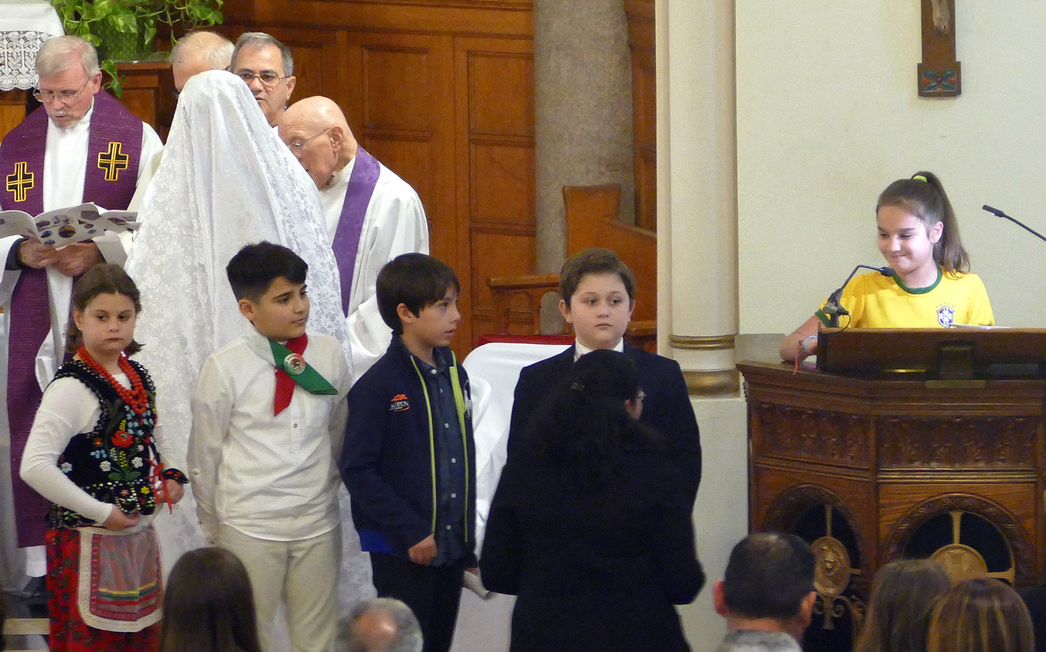 Youth of the parish offer prayers of the faithful.