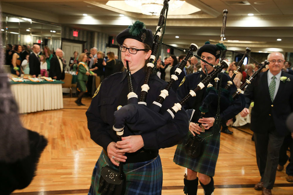 Bagpipers add to the reception's festive atmosphere.