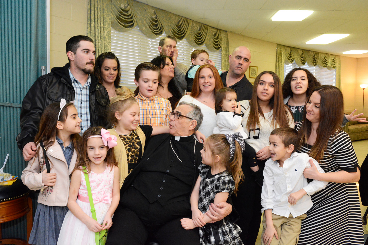 Relatives of Bishop Lagonegro make memories as they gather at the party.