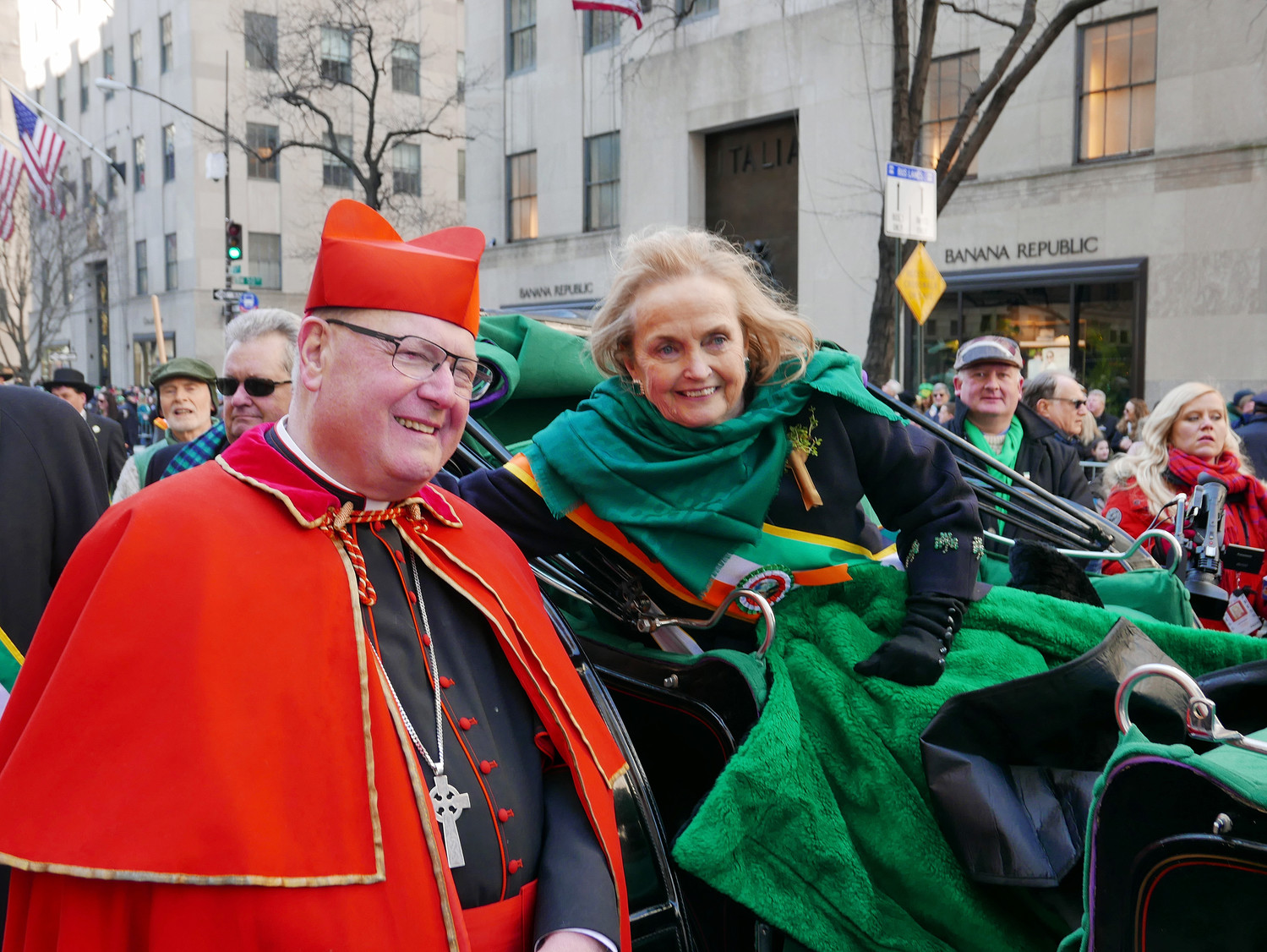 Cardinal Dolan greets Loretta Brennan Glucksman, the grand marshal of the 257th New York City St. Patrick's Day Parade, who led the March 17 march up Fifth Avenue while riding with her grandson, Liam Picco, 15, in their favorite hansom cab.