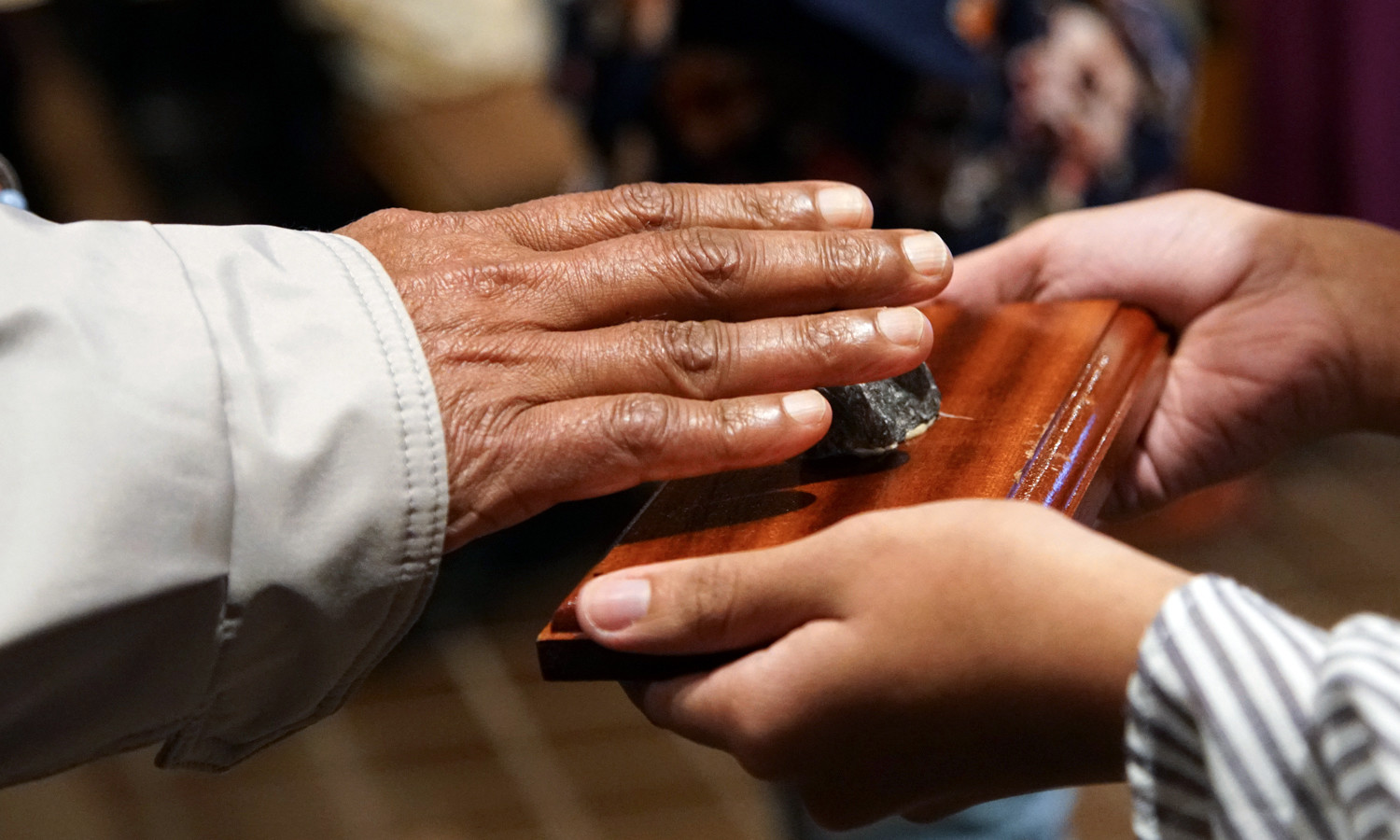 Parishioners touch the grotto relics.