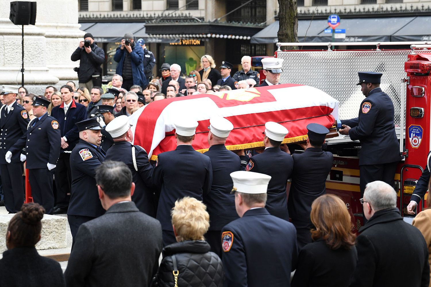 The casket of FDNY Lt. Michael R. Davidson, of Engine Company 69 in Manhattan, is lowered from a fire truck and released to pallbearers before the Funeral Mass Cardinal Dolan celebrated March 27 at St. Patrick's Cathedral.