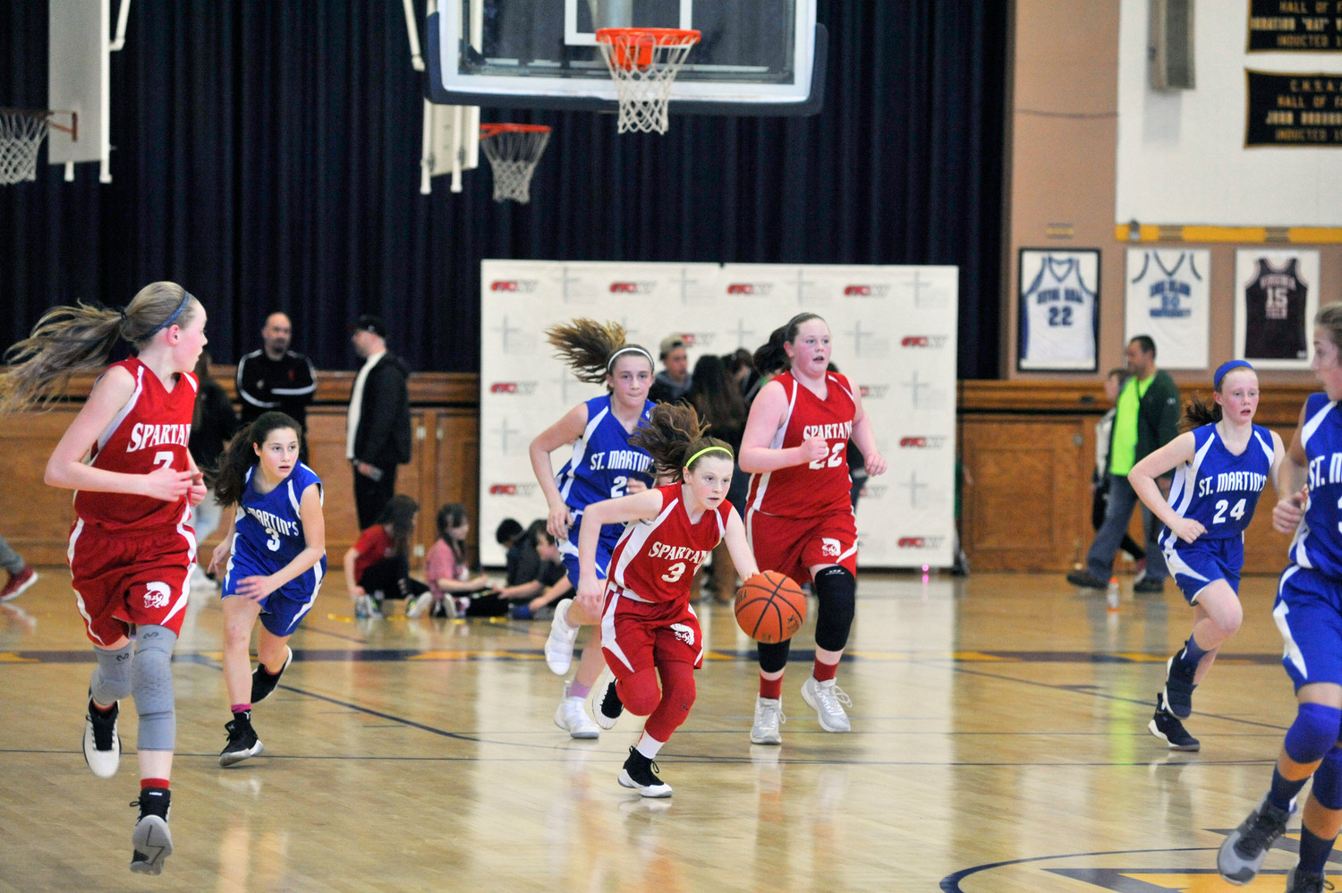 Sacred Heart's Olivia Schmitt dribbles during the sixth-grade girls' game against St. Martin de Porres, Poughkeepsie. Sacred Heart won 44-20.
