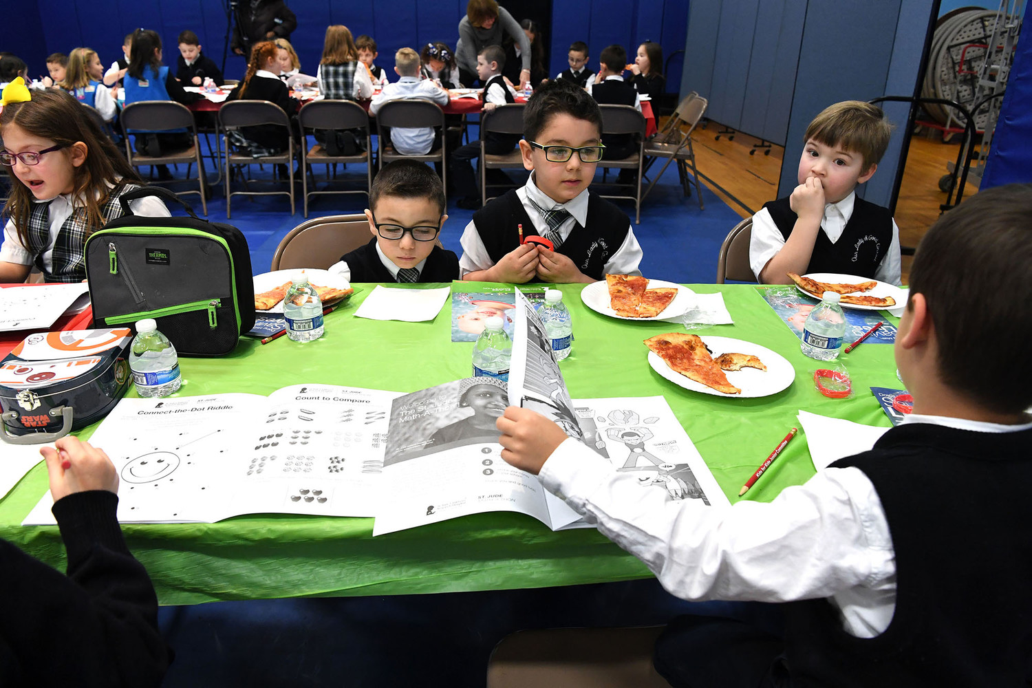 Students enjoy pizza donated by Denino's on Staten Island as they seek answers.