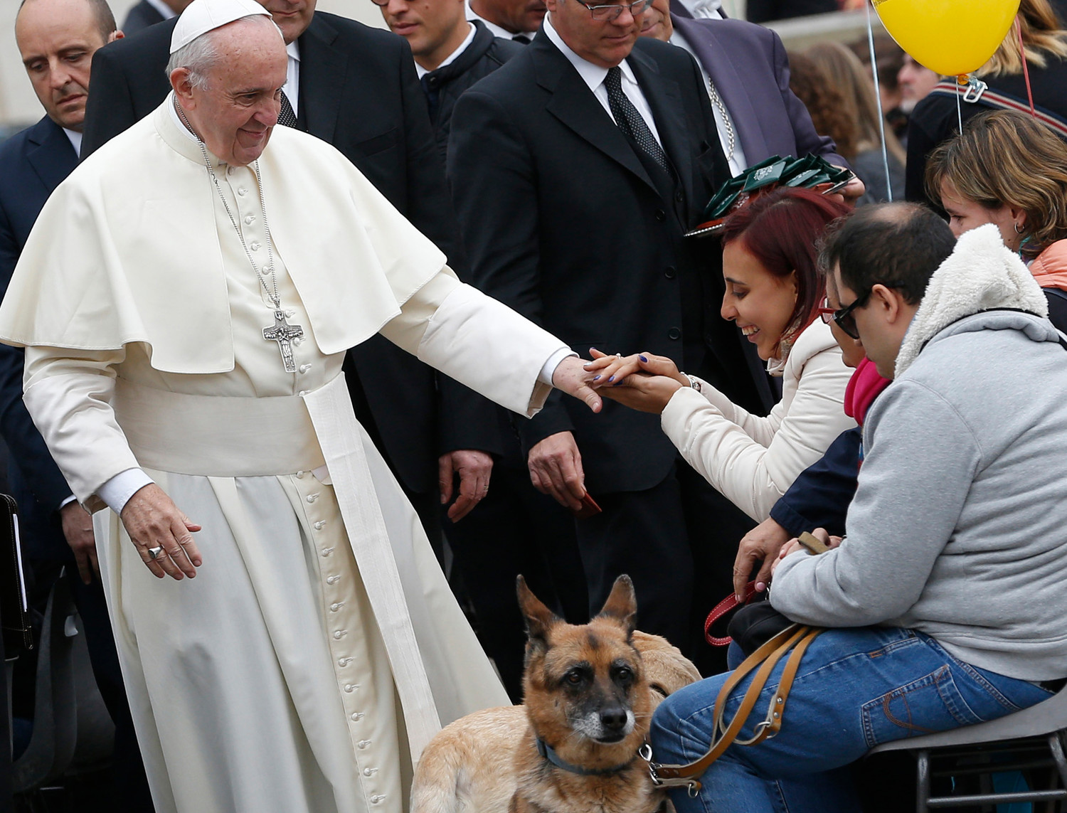 "Pope Francis greets visually impaired people, accompanied by their dogs, during his general audience in St. Peter's Square at the Vatican Oct. 18, 2017. In his exhortation, ""Gaudete et Exsultate"" (""Rejoice and Be Glad""), the pope says that the path to holiness is made up of small steps in prayer, in sacrifice and in service to others."