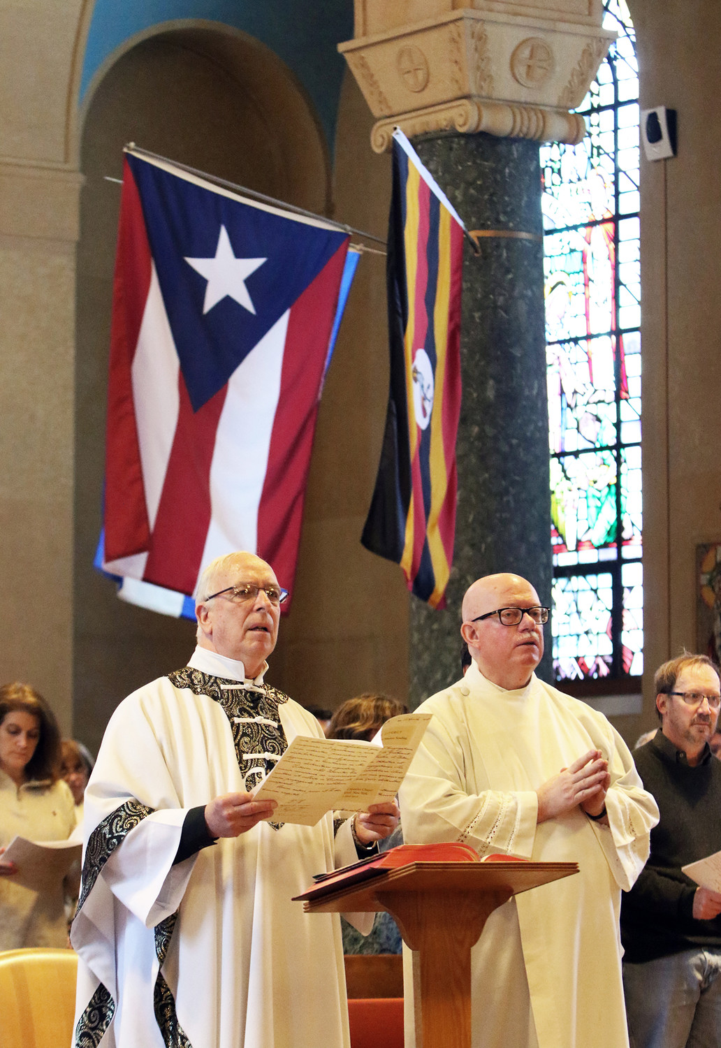 Father Raymond J. Finch, M.M., left, superior general of the Maryknoll Fathers and Brothers, and Father Michael Walsh, M.M., pray during Mass April 2 at the Maryknoll Society Center in Ossining.