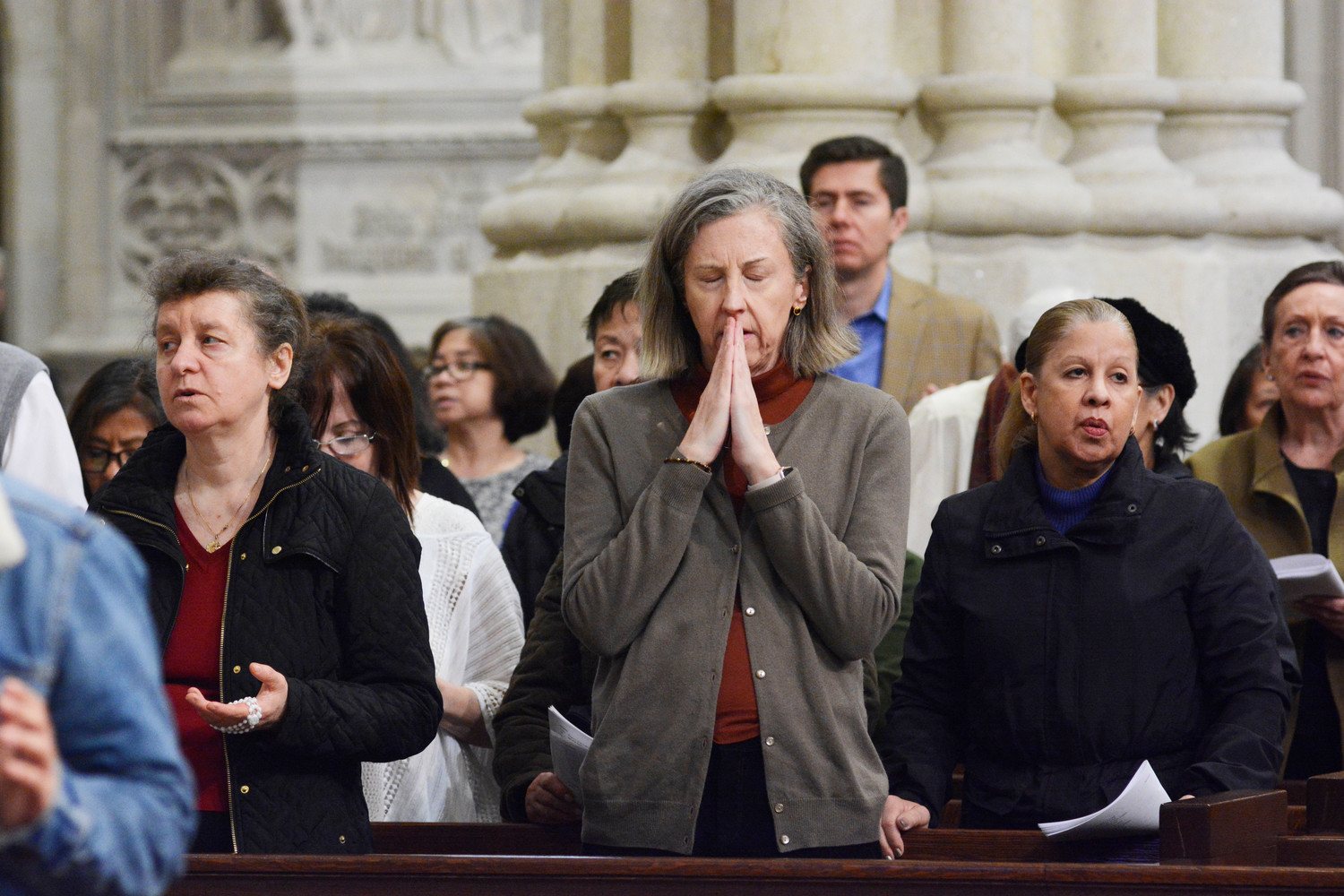 Congregants pray at the cathedral during the Three Hours' Reflection on the Passion and Death of Jesus.