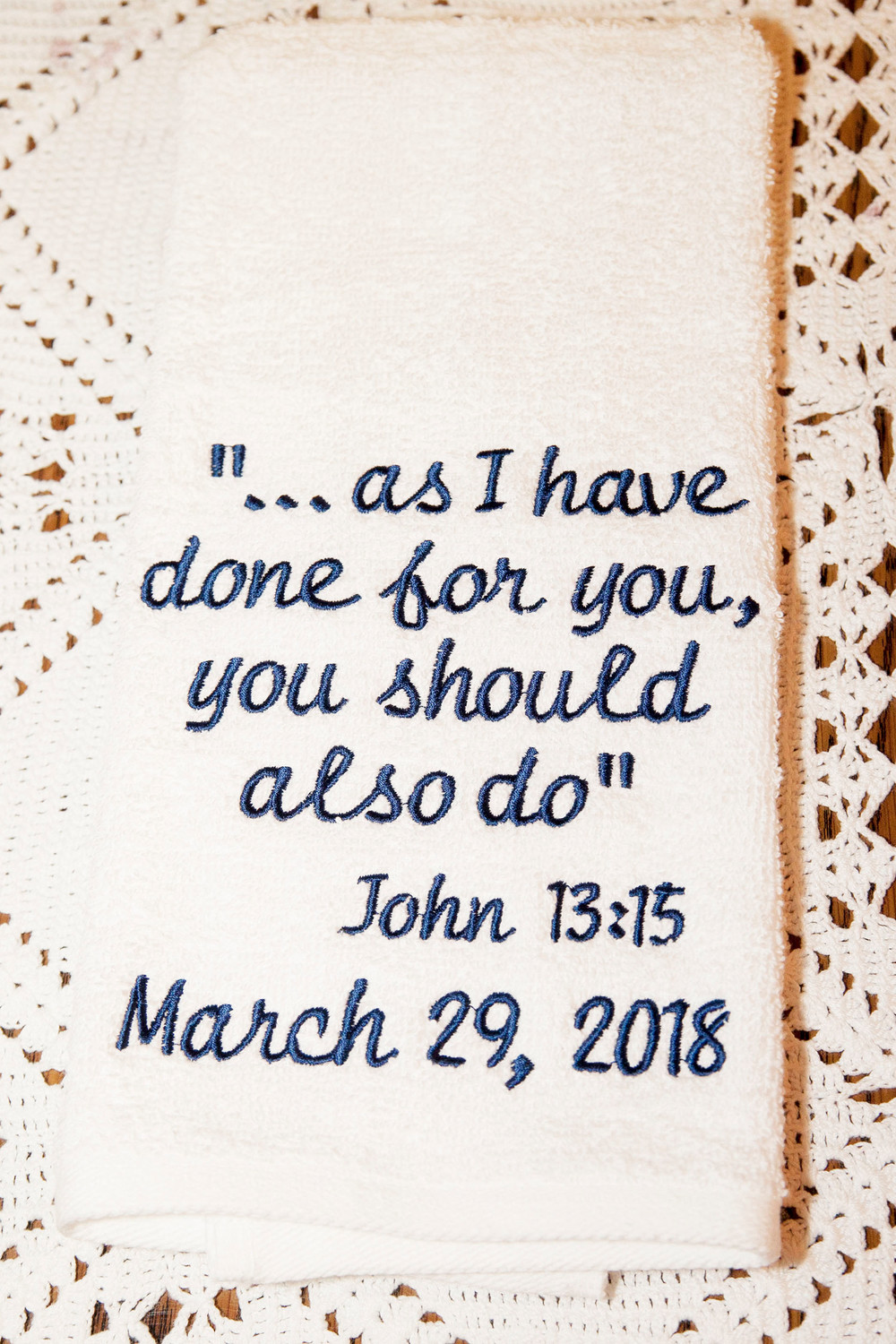 Each of the faithful whose feet were washed during the Holy Thursday liturgy at St. Denis was given a towel inscribed with a Scripture verse from the Gospel of John.