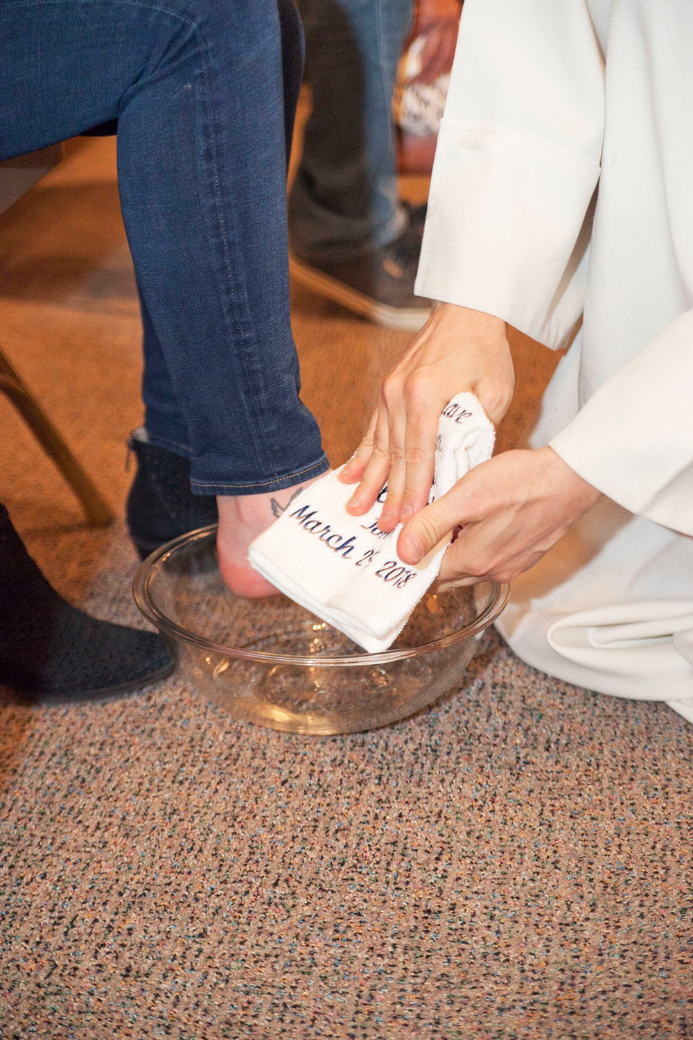 A foot of another parishioner is washed during the Holy Thursday rite at St. Denis.