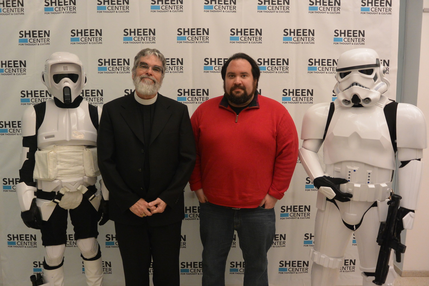 "VISIT FROM THE GALACTIC EMPIRE—Brother Guy Consolmagno, S.J., left, director of the Vatican Observatory, and Fordham University professor Dr. Charles Camosy are flanked by stormtroopers before ""Jesuits and Jedi: Science and Spirituality in the Age of Star Wars"" at the Sheen Center for Thought & Culture in lower Manhattan April 10."