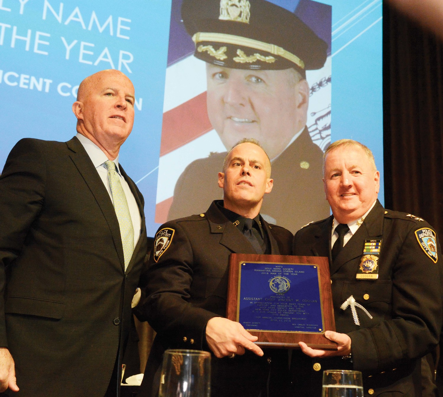 Assistant Chief Vincent Coogan, executive officer of the NYPD Transit Bureau, right, accepts the 2018 Man of the Year Award for the Holy Name Society of Manhattan, Bronx and Staten Island at the organization's centennial Communion Breakfast April 22 at the New York Hilton Midtown in Manhattan. From left, NYPD Police Commissioner James O'Neill and NYPD Det. Robert Barrett, president of the Holy Name Society.
