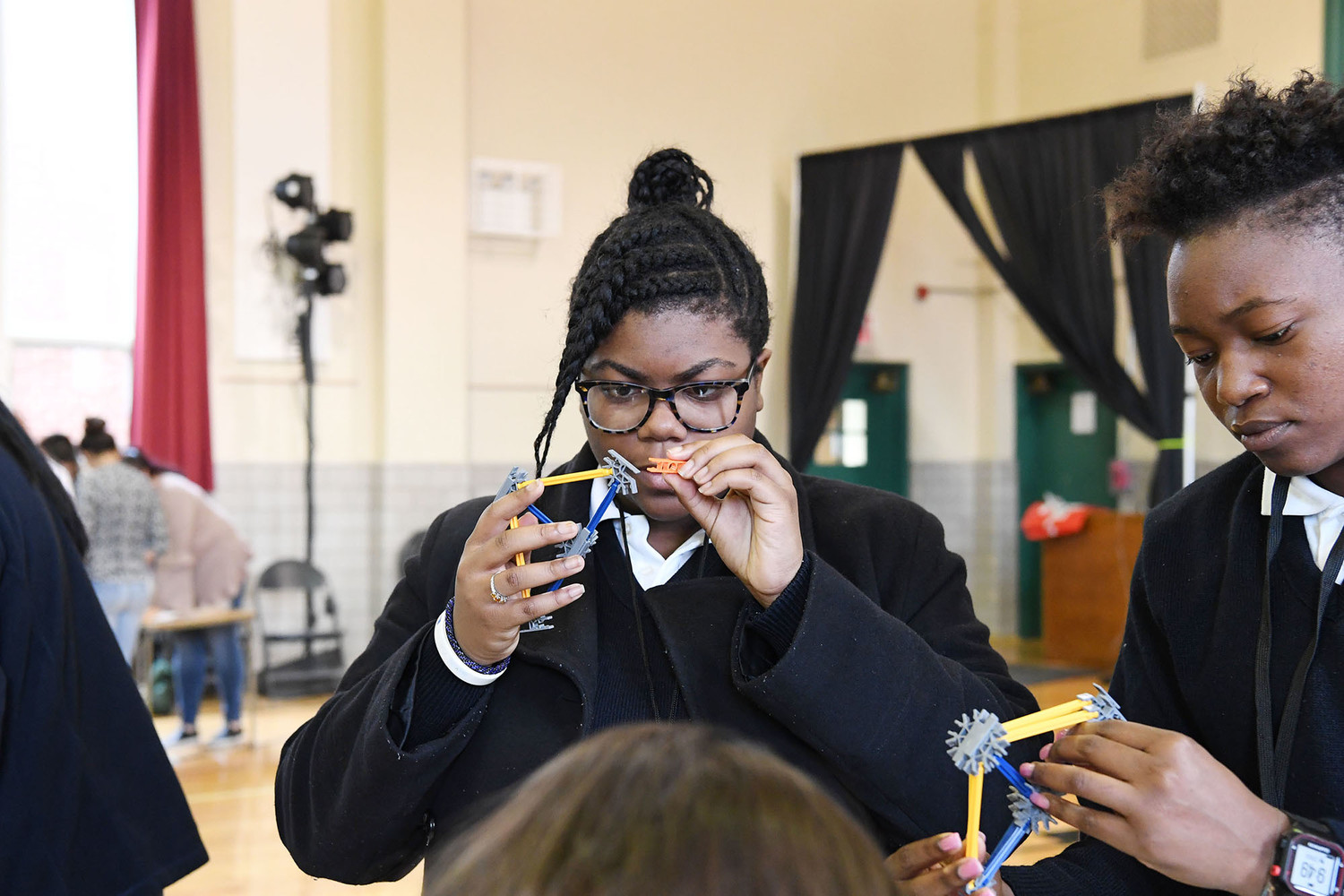 Notre Dame Academy's bridge experiment included attentive work by Lizzie Egbe and Nyoka Banes.