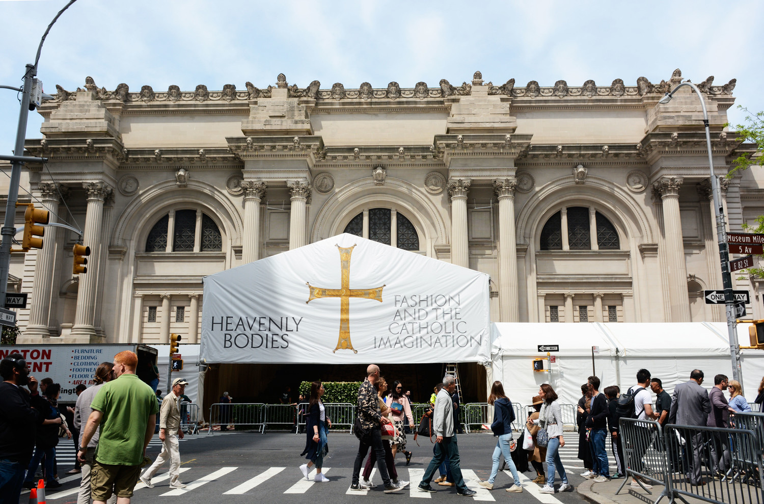 "Large sign announcing the ""Heavenly Bodies: Fashion and the Catholic Imagination"" exhibit drapes the Metropolitan Museum of Art's entrance on Fifth Avenue in Manhattan May 7."