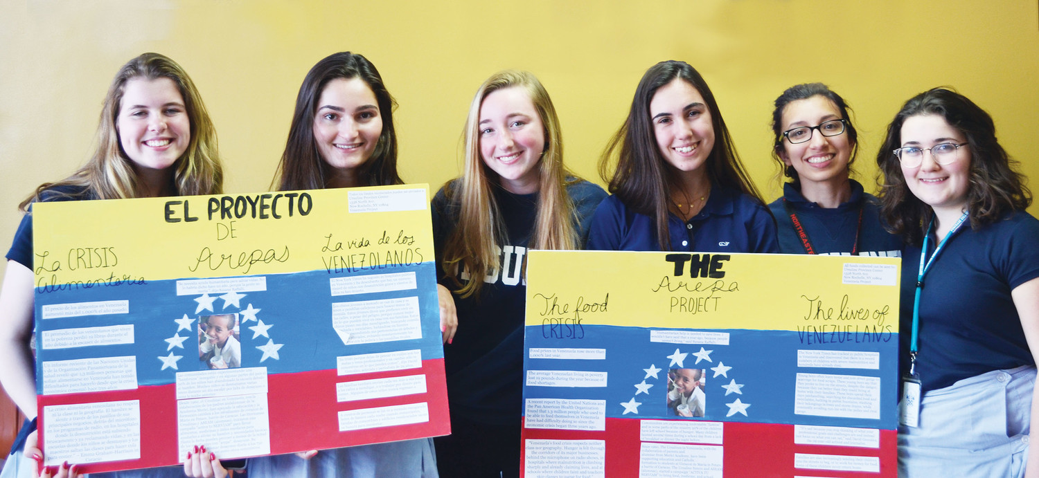 Students from The Ursuline School in New Rochelle show their Arepa Project Spanish/English boards during the May 1 gathering at Arepa Mania restaurant in New Rochelle. The seniors in the Spanish 5 Honors class are, from left, Jillian Farrell, Katherine Schuerger, Winnifred Ryan, Vittoria Gallello, Maria Bauer-Rowe and Alicia McMillan.