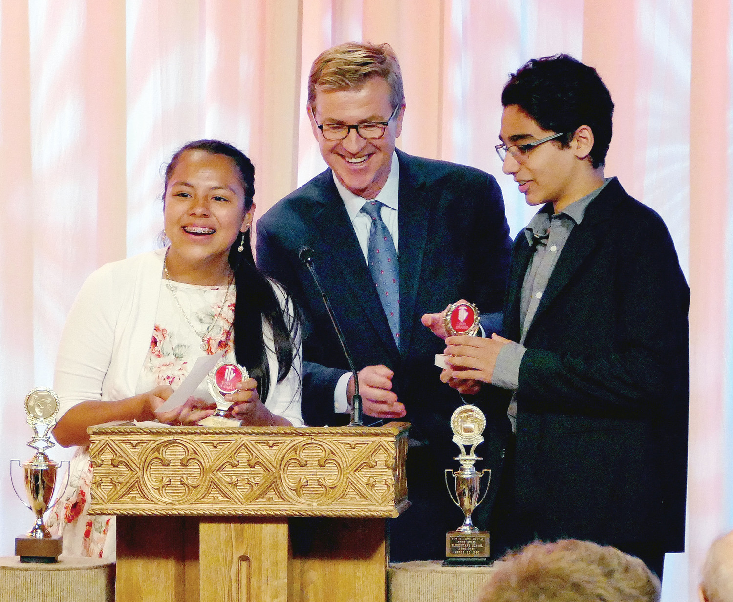 Dick Brennan of WCBS-TV presents the awards to the Best Elementary School Anchors Brittany Reyes and Tristan Murray of St. Peter School, Poughkeepsie.