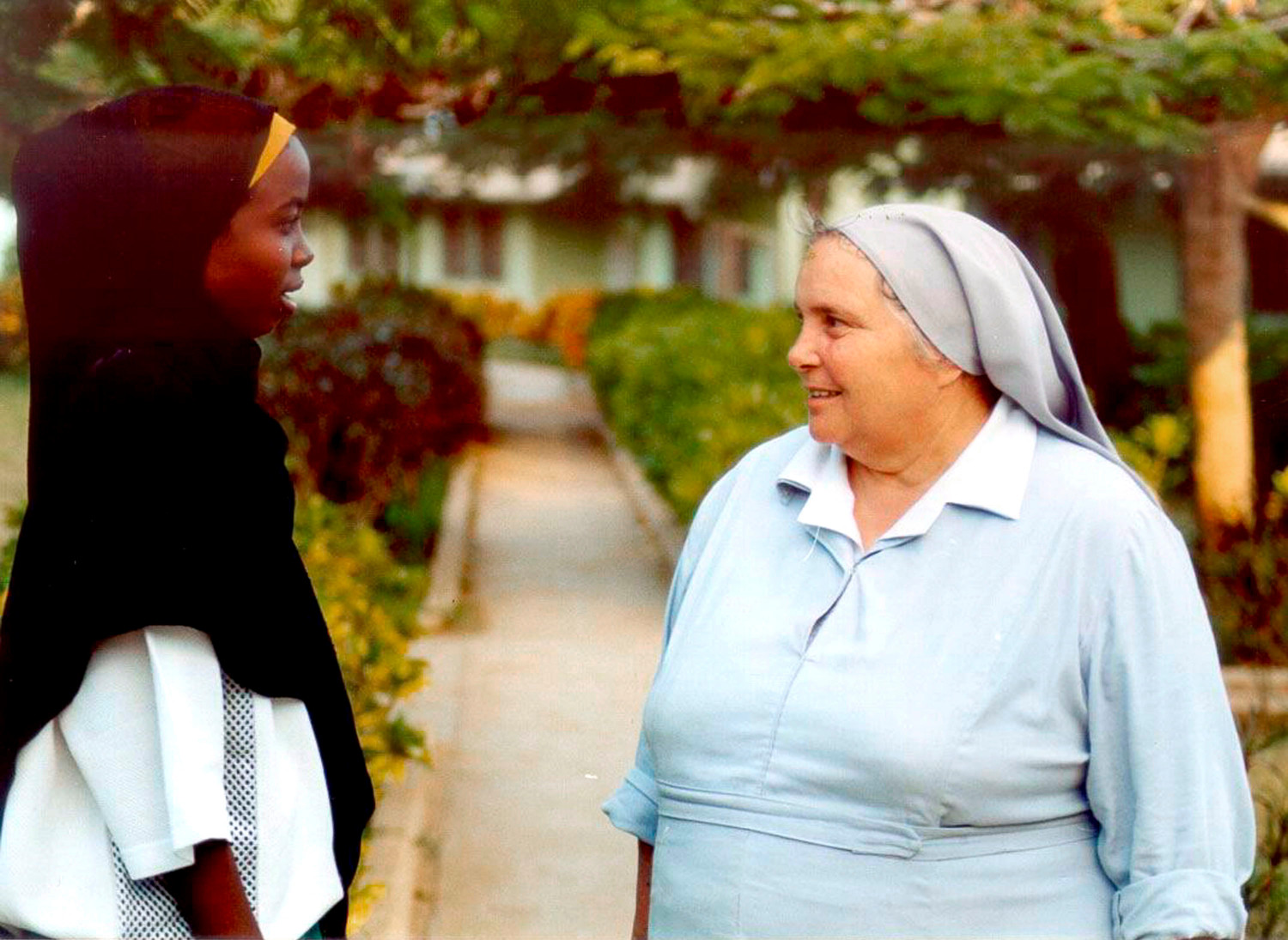 Sister Leonella Sgorbati, right, is seen in an undated photo speaking with a girl in Mogadishu, Somalia.