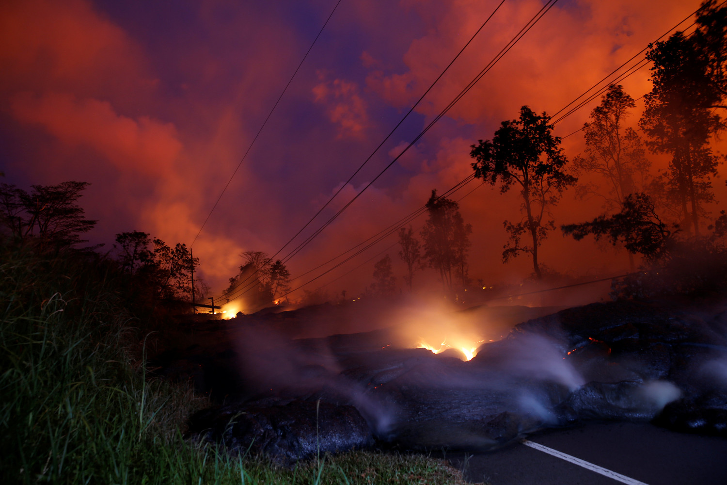 Volcanic gases rise from the Kilauea lava flow that crossed Pohoiki Road near Pahoa, Hawaii, May 28.